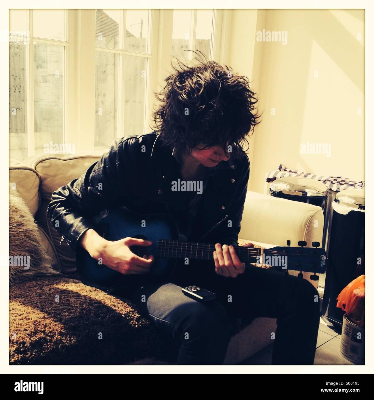 Playing Guitar - Stock Image