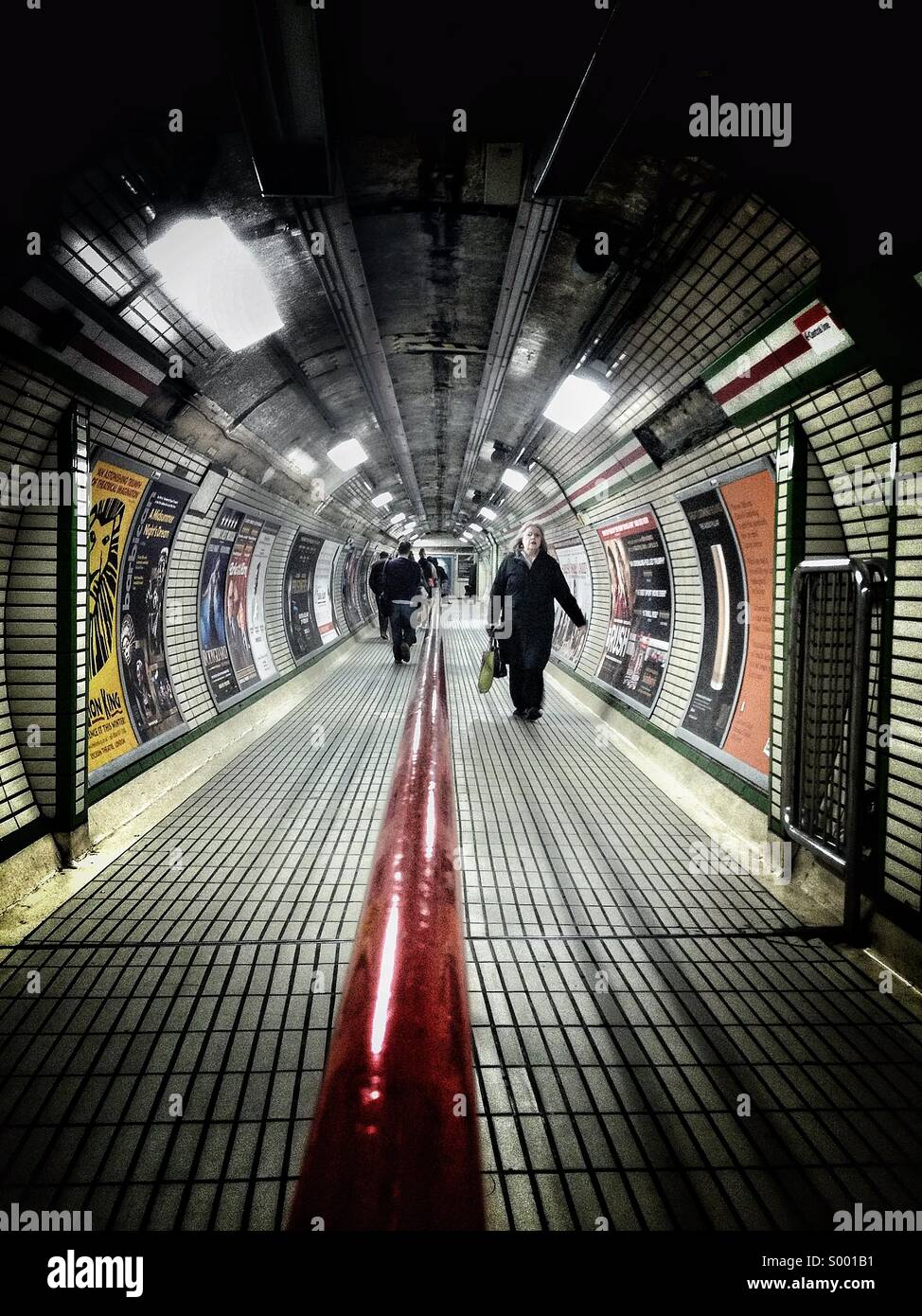 Commuters at London Underground - Stock Image