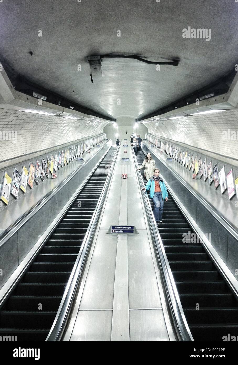People going down the stairs at Kentish Town Underground - London - Stock Image