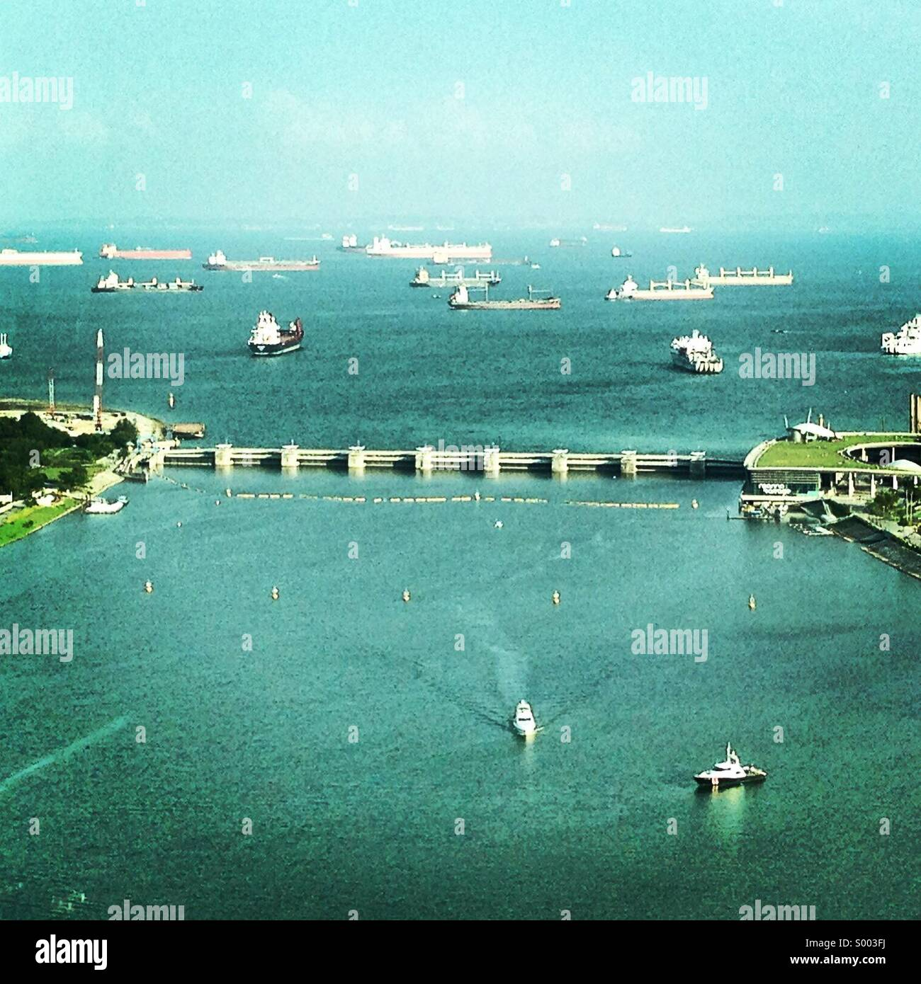 Ships waiting at the port in Singapore - Stock Image