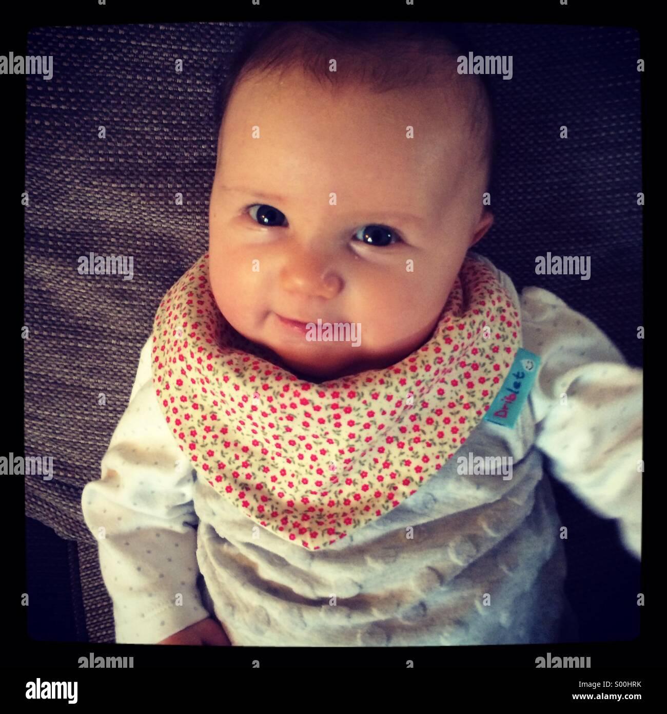 Baby girl aged 12 weeks - Stock Image
