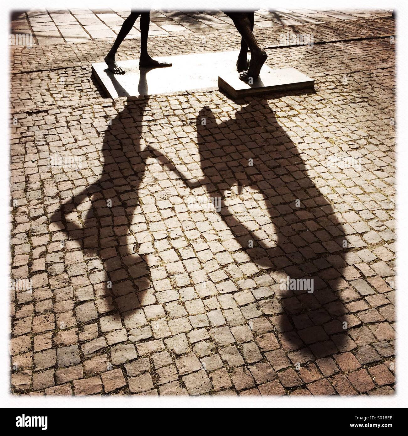 Shadow of a statue in Sindelfingen Germany - Stock Image
