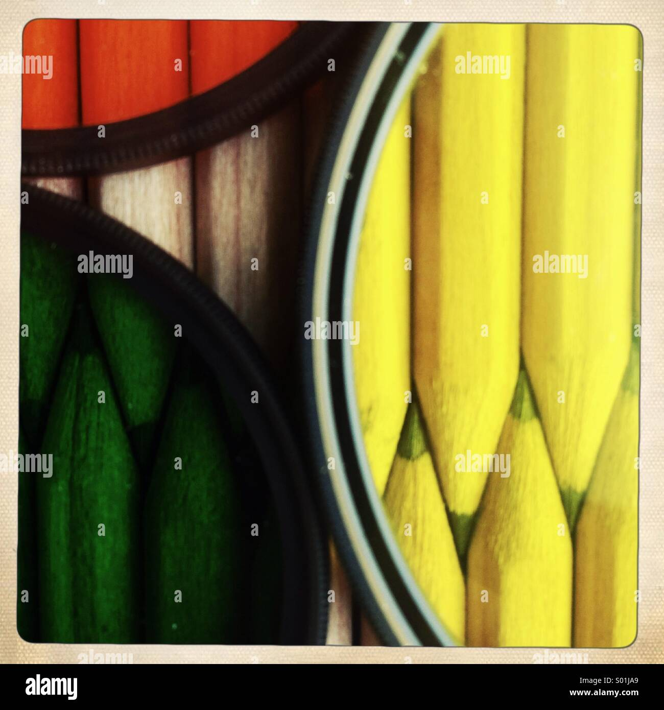 Pencils behind color photographic filters - Stock Image