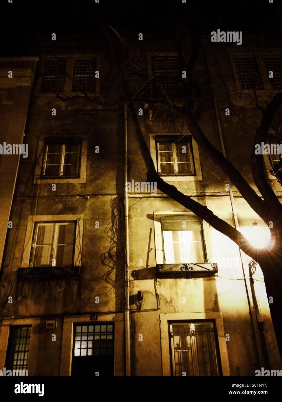 Tall building at night, Lisbon - Stock Image