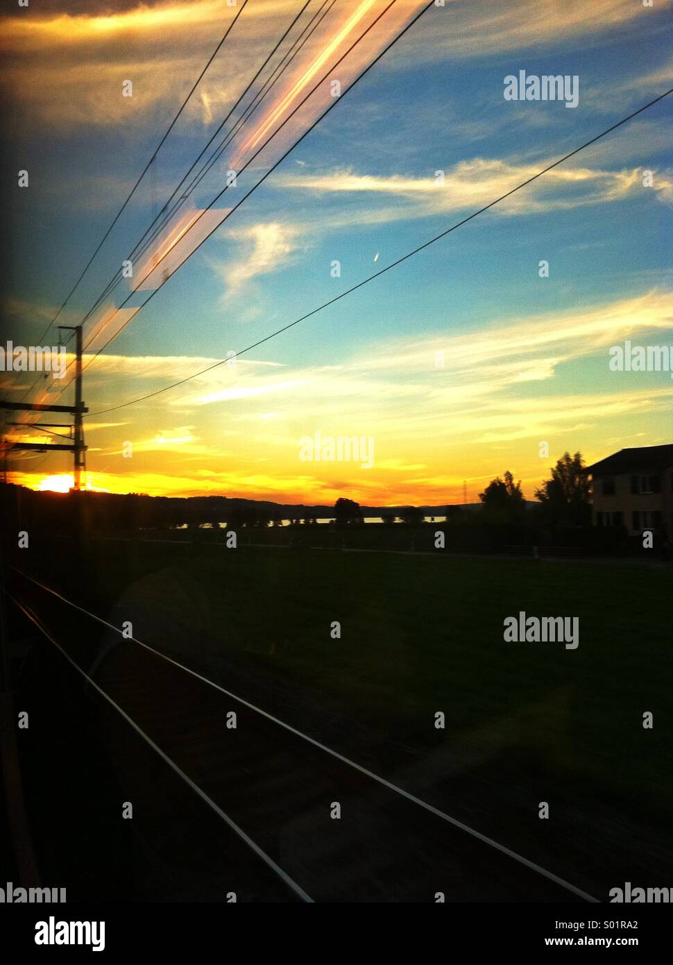 Train track power lines sunset - Stock Image