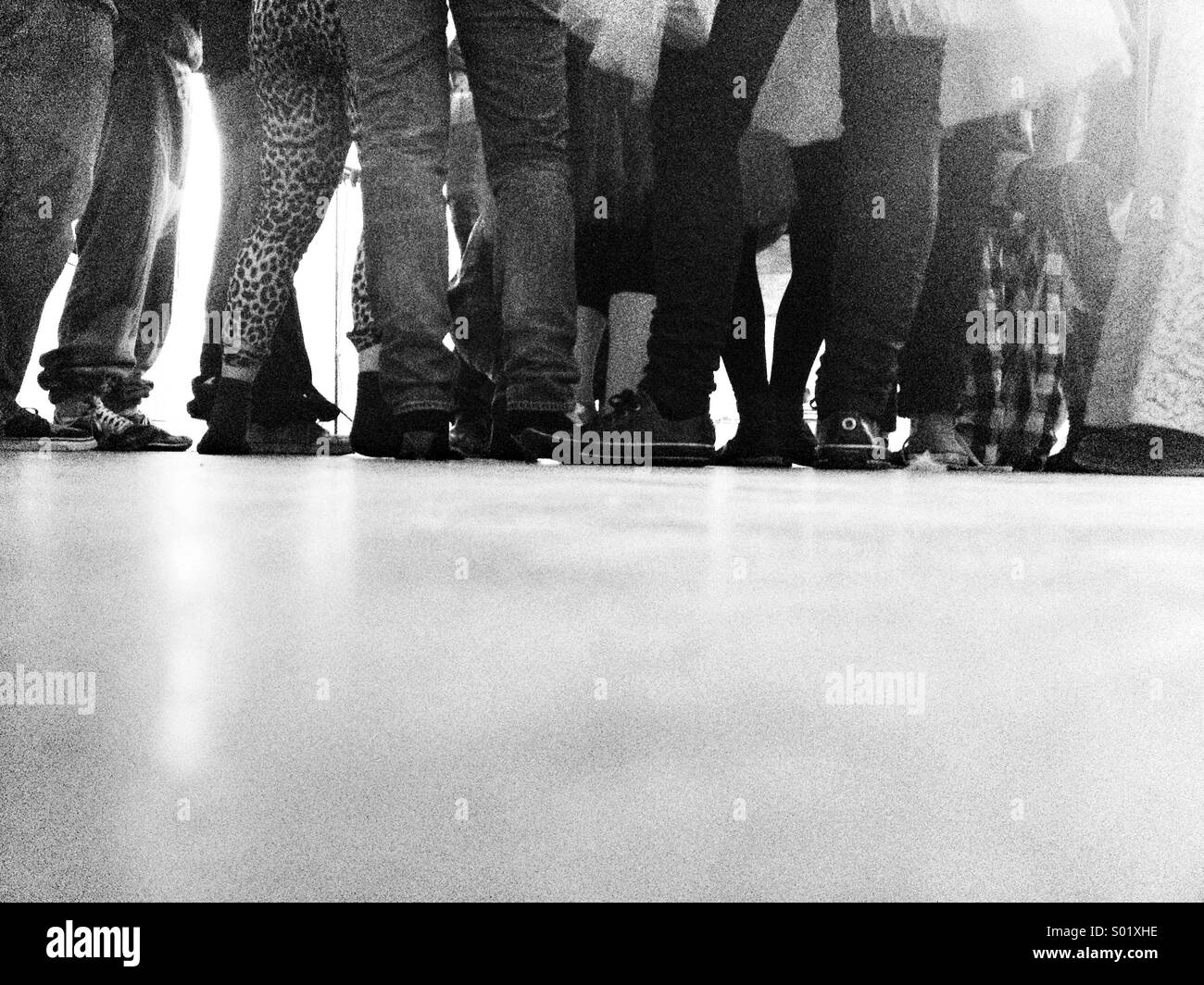 People gathering view of legs - Stock Image