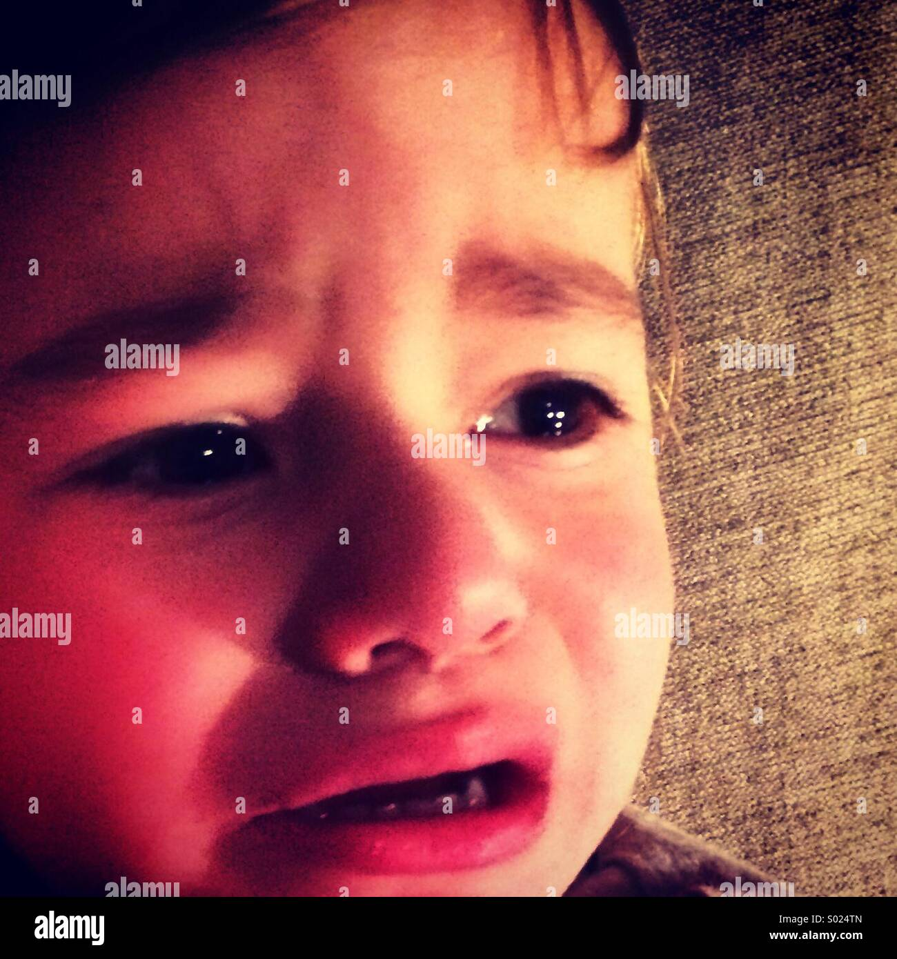 Two year old boy crying. - Stock Image