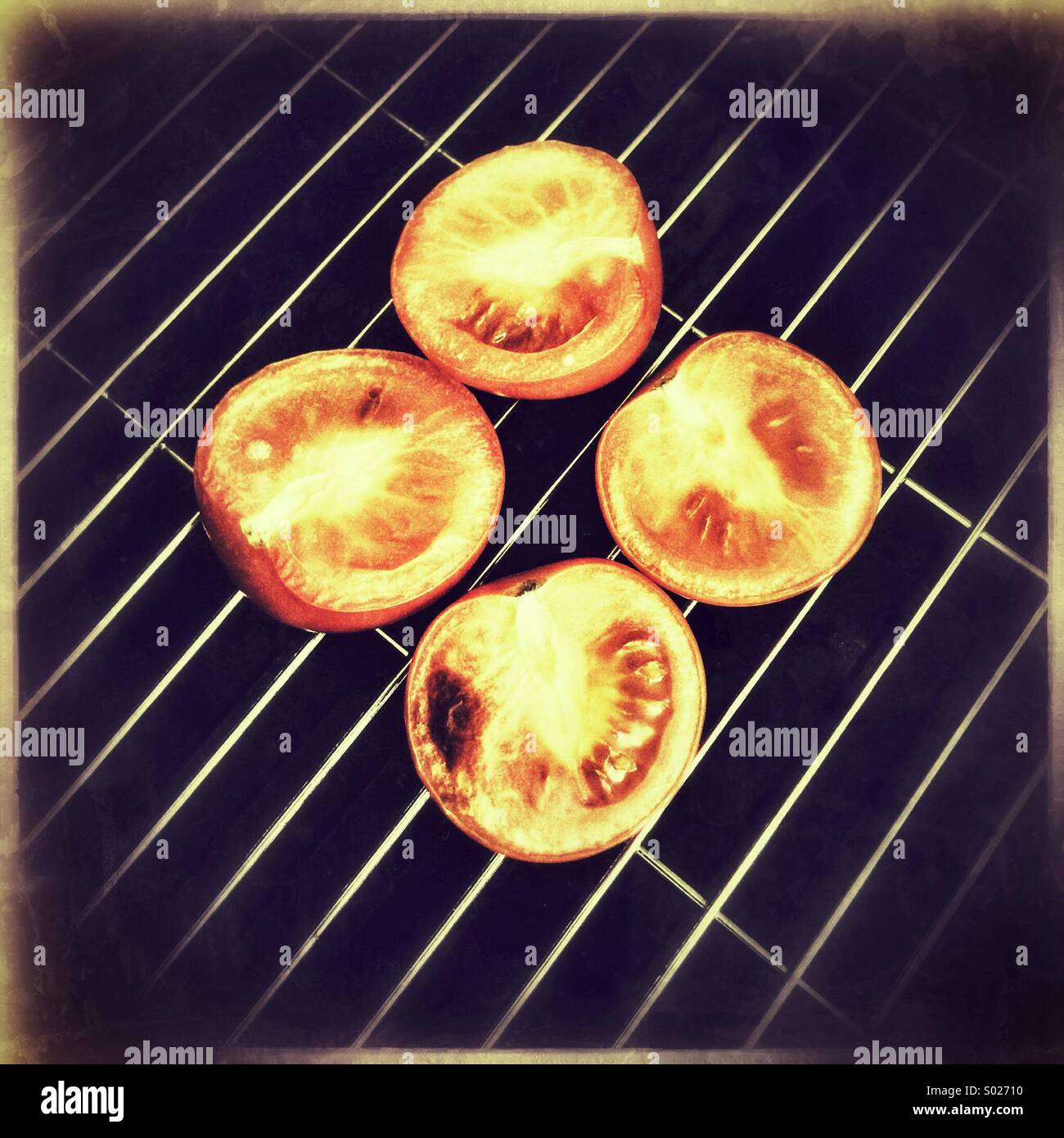 Tomatoes on grill pan Stock Photo