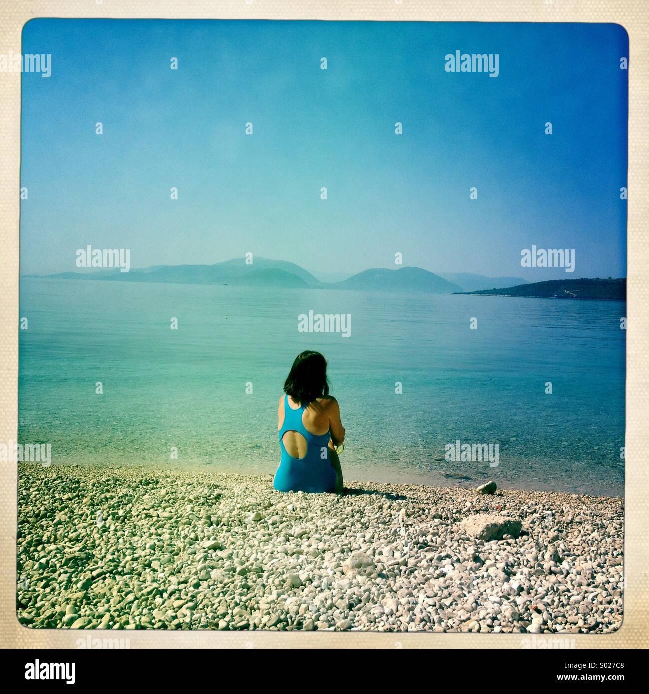 Woman alone on beach, Lefkada, Greece - Stock Image