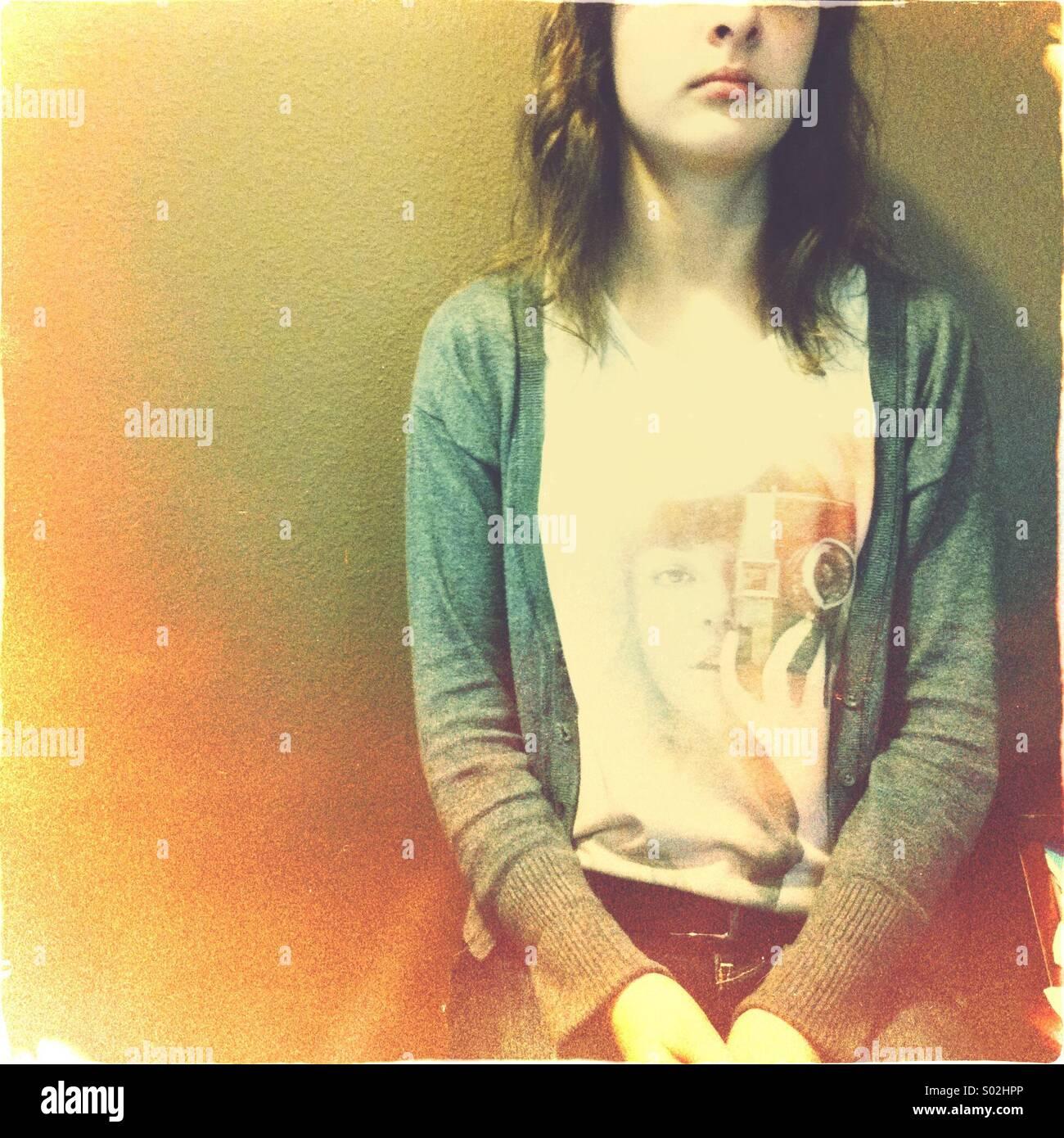girl wearing camera t-shirt - Stock Image