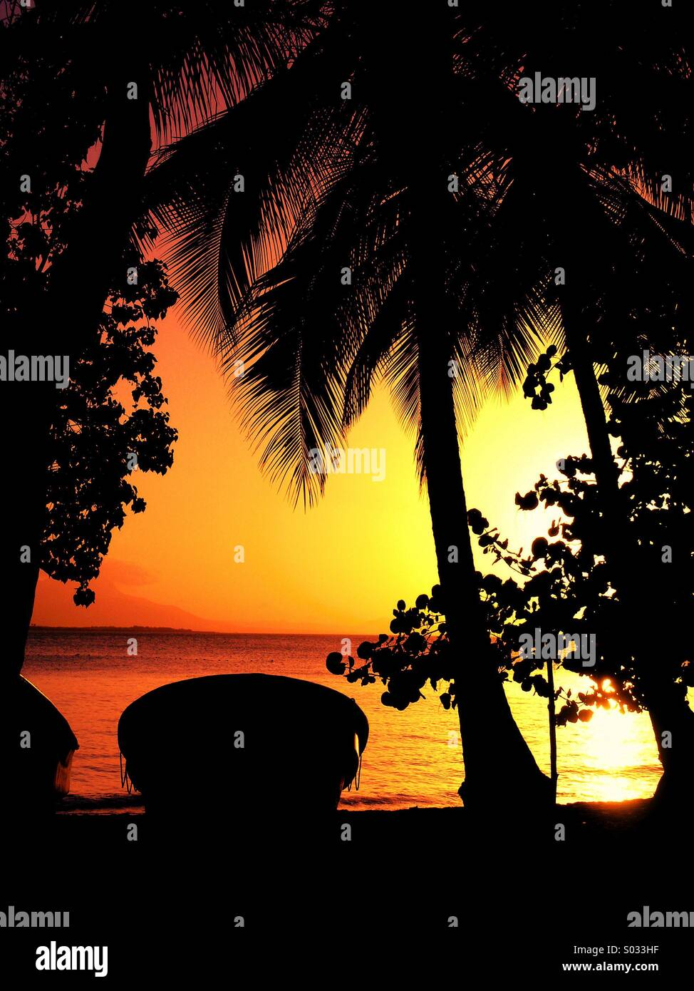 caribbean-sunset-beach-boat-S033HF.jpg