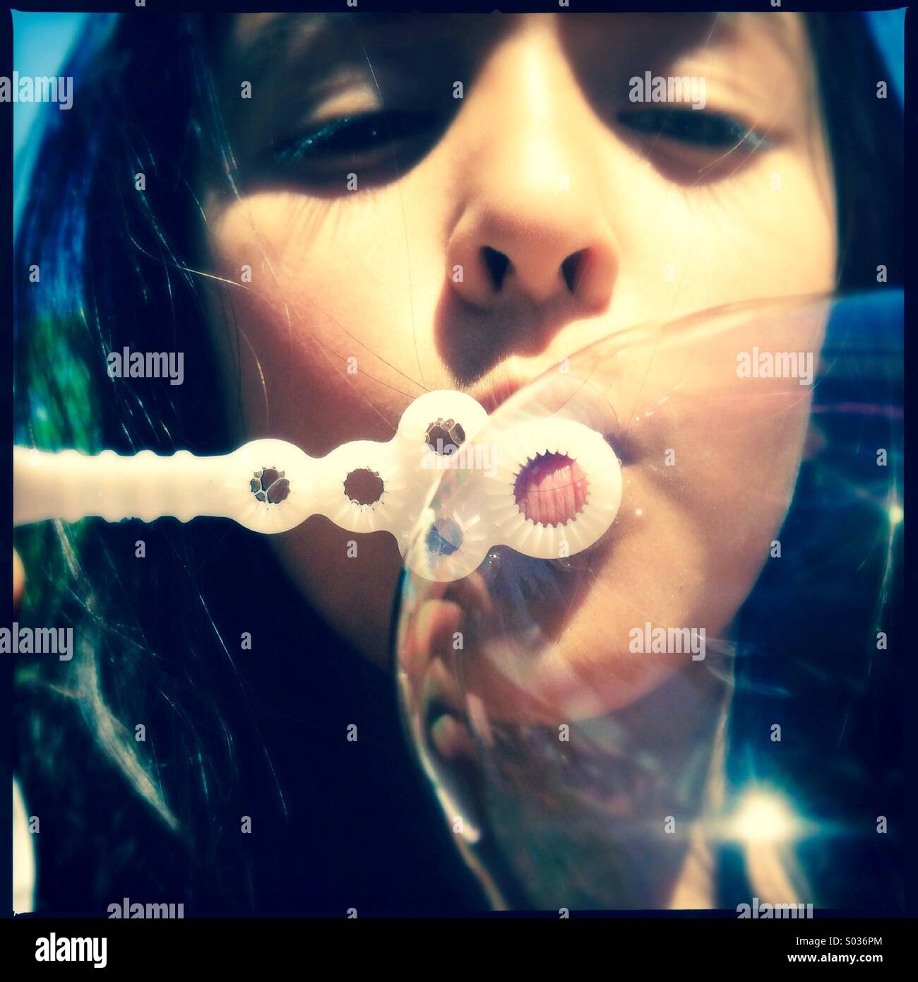 Girl blowing bubble - Stock Image