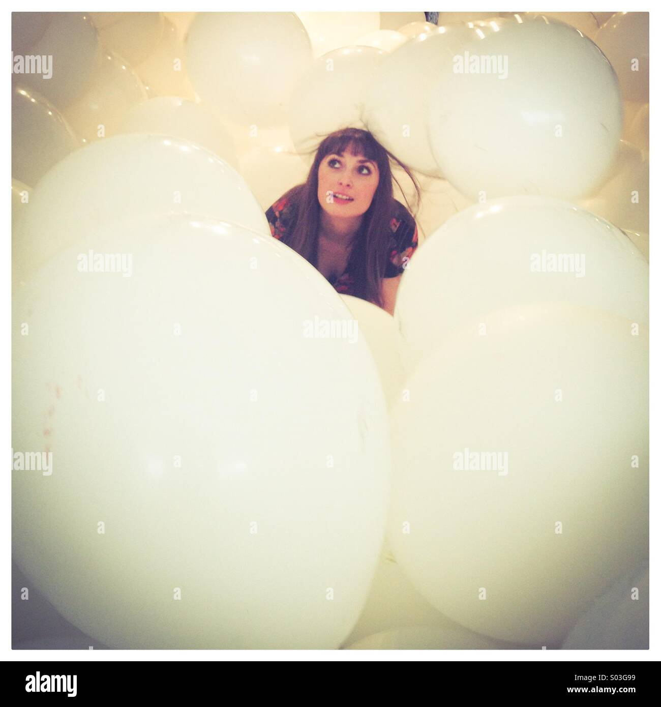 Girl in balloons - Stock Image