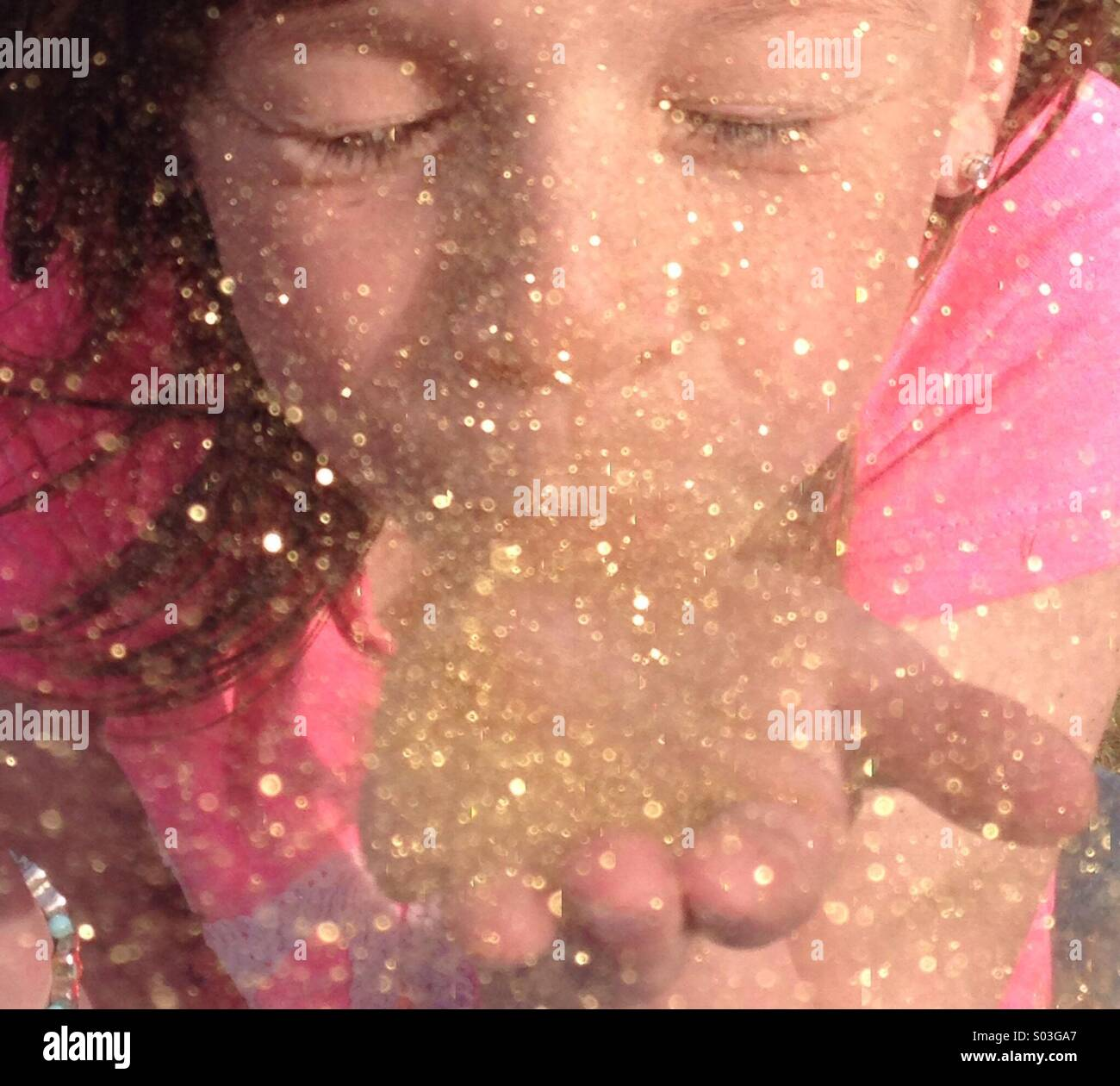Blowing glitter - Stock Image