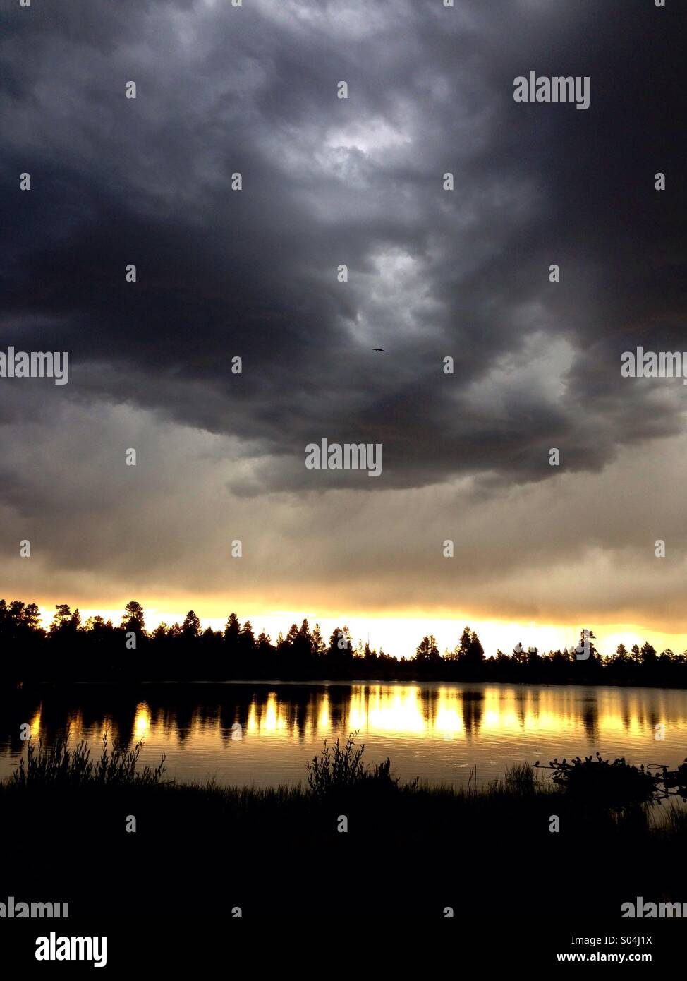 Lake with clouds at sunset - Stock Image
