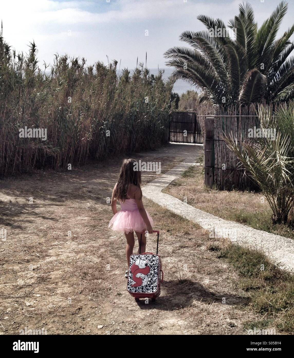 Girl going on holiday - Stock Image