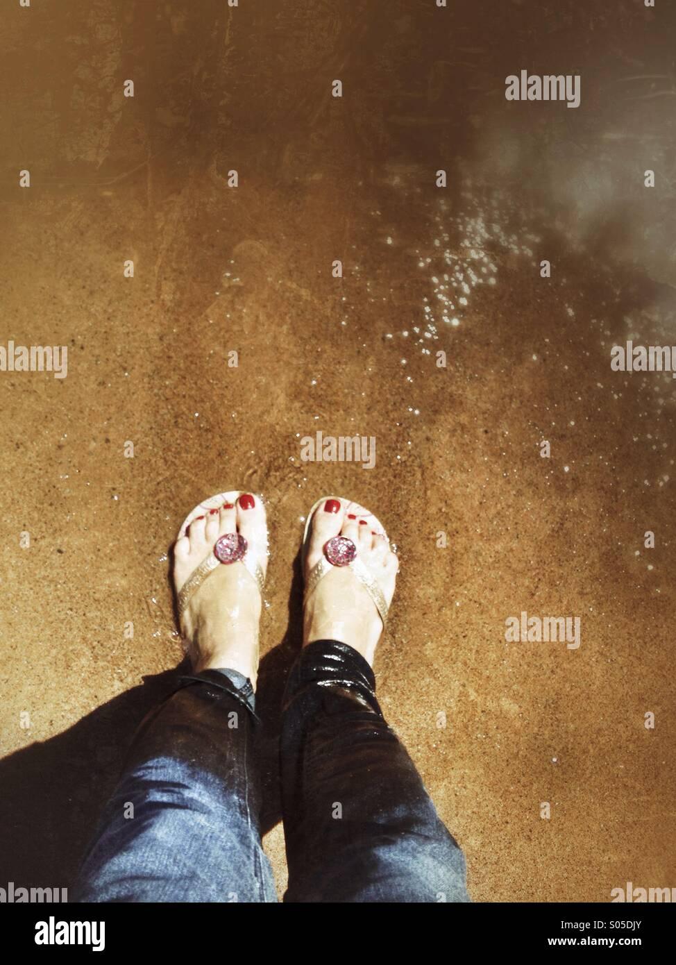 Feet on beach - Stock Image