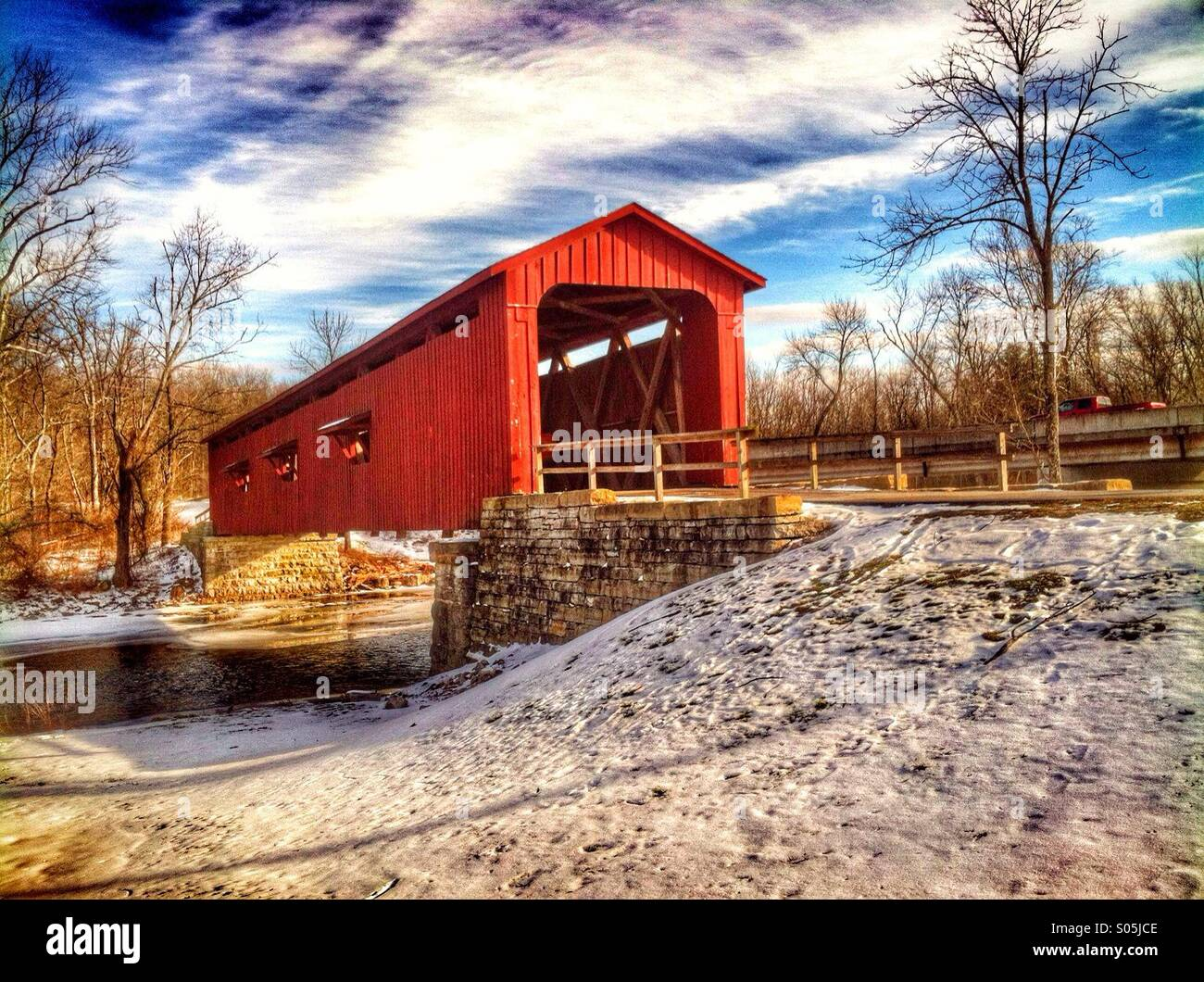 The Red Covered Bridge - Stock Image