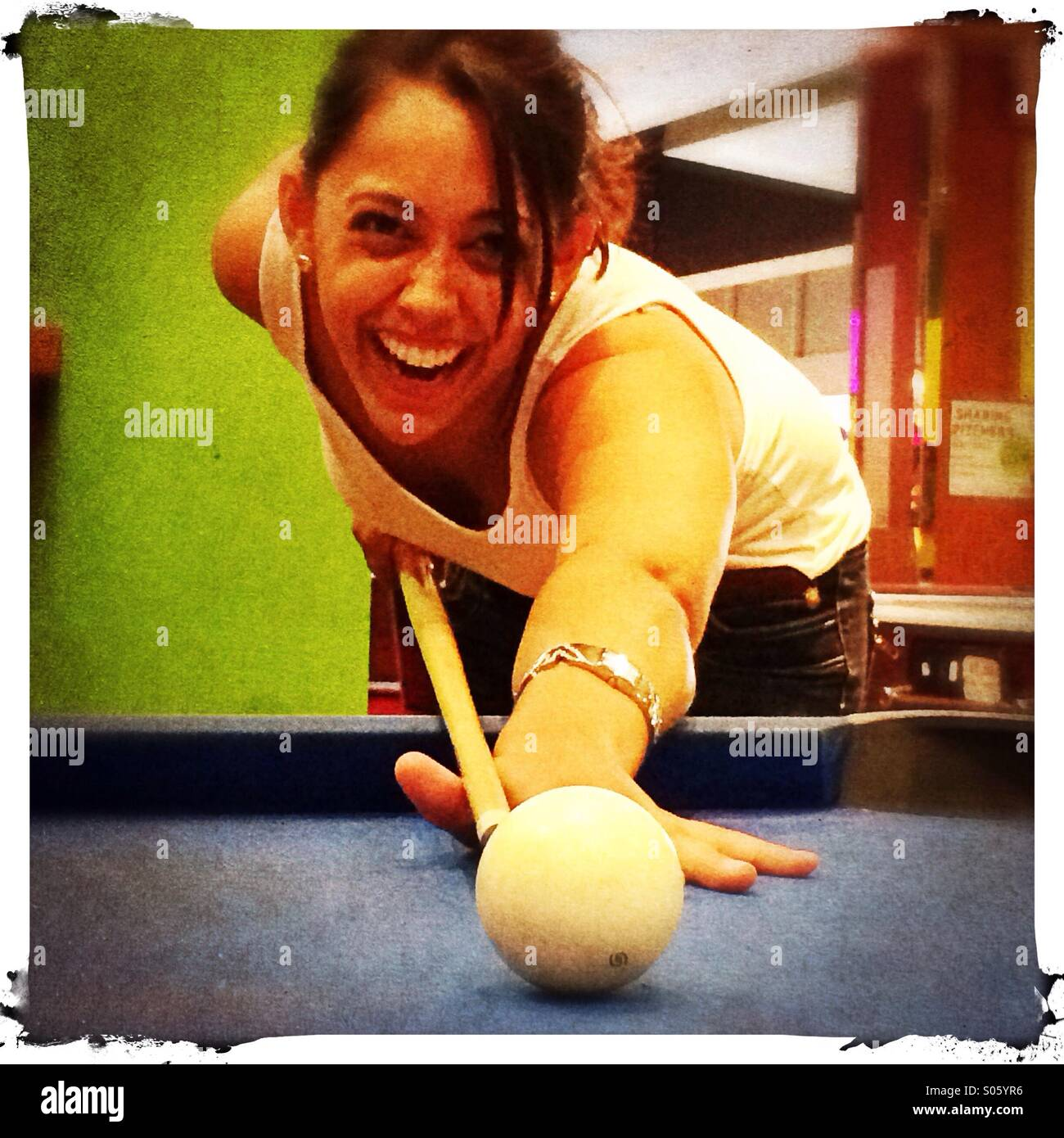 young-woman-playing-pool-uk-S05YR6.jpg