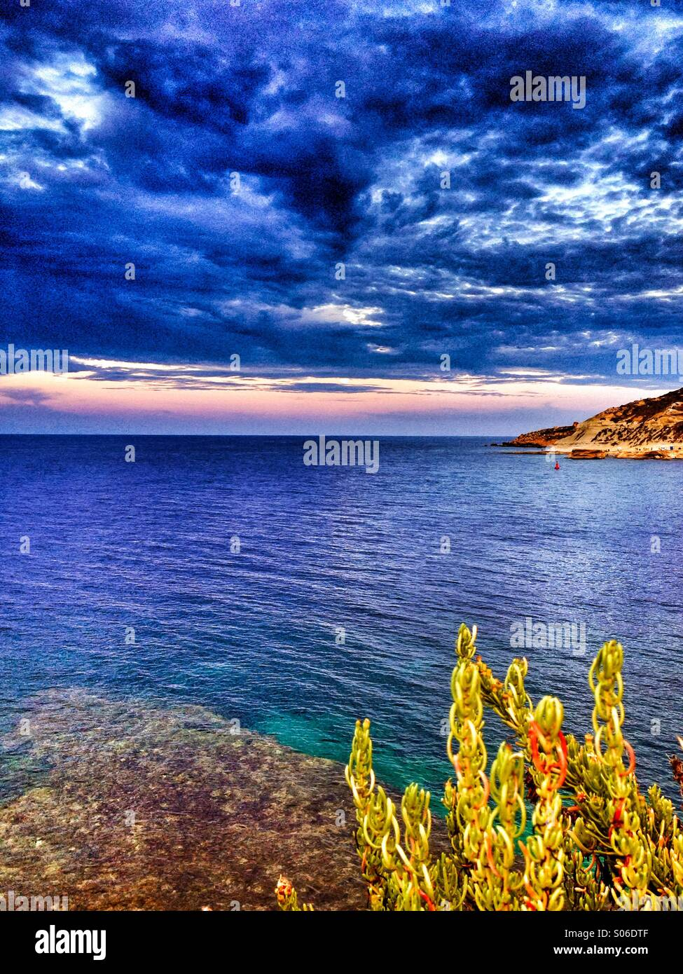 Summer storm clouds gathering over a harbour - Stock Image