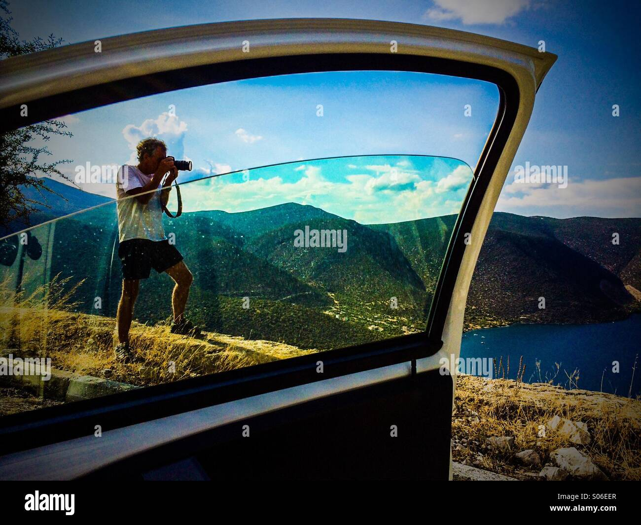 Photographer taking a landscape photo in Evia Island Greece - Stock Image