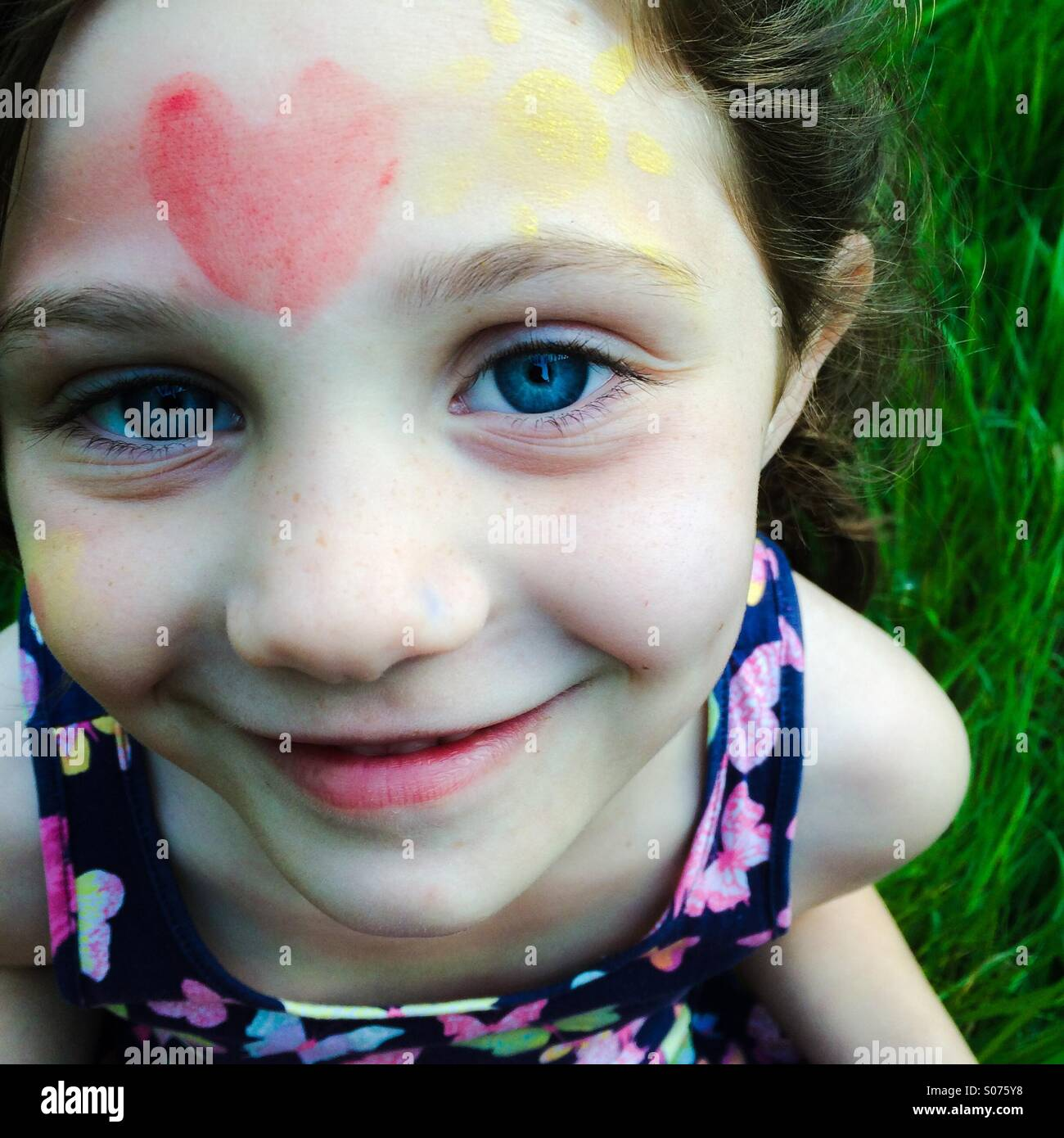 5 year old girl with face painting - Stock Image