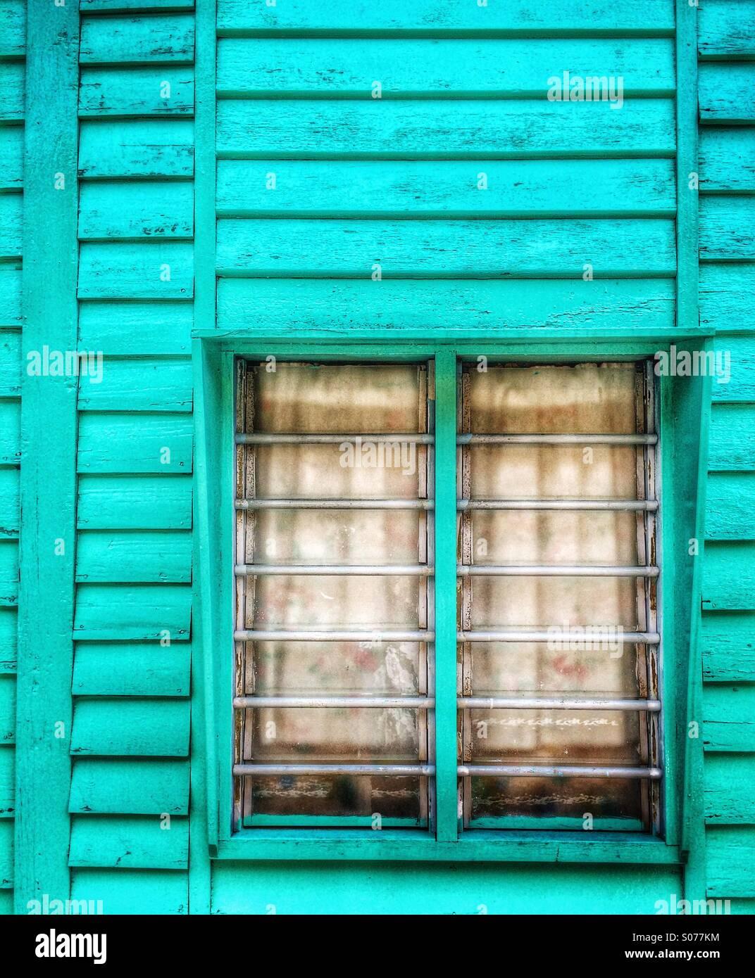 Malaysia old wooden house window at Crab Island fishing village Pulau Ketam - Stock Image