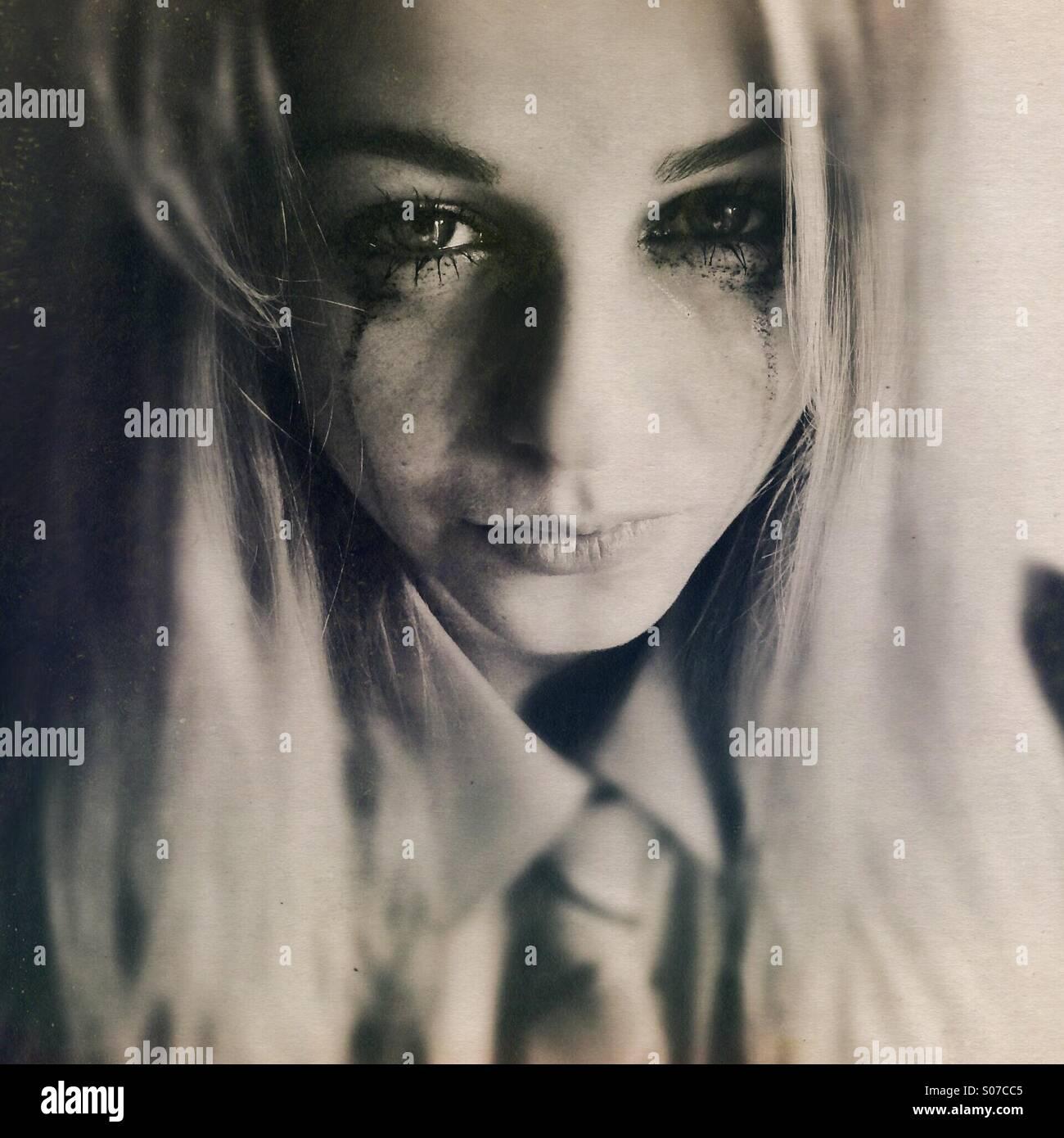 Teenage girl in school uniform, crying - Stock Image