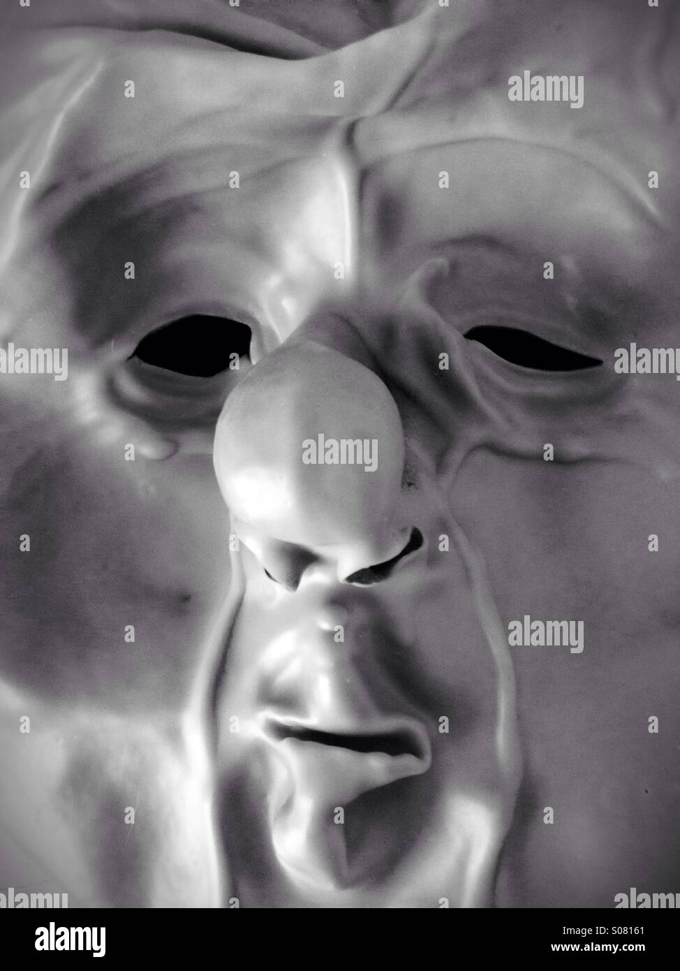 A grotesque face mask turned inside out. - Stock Image