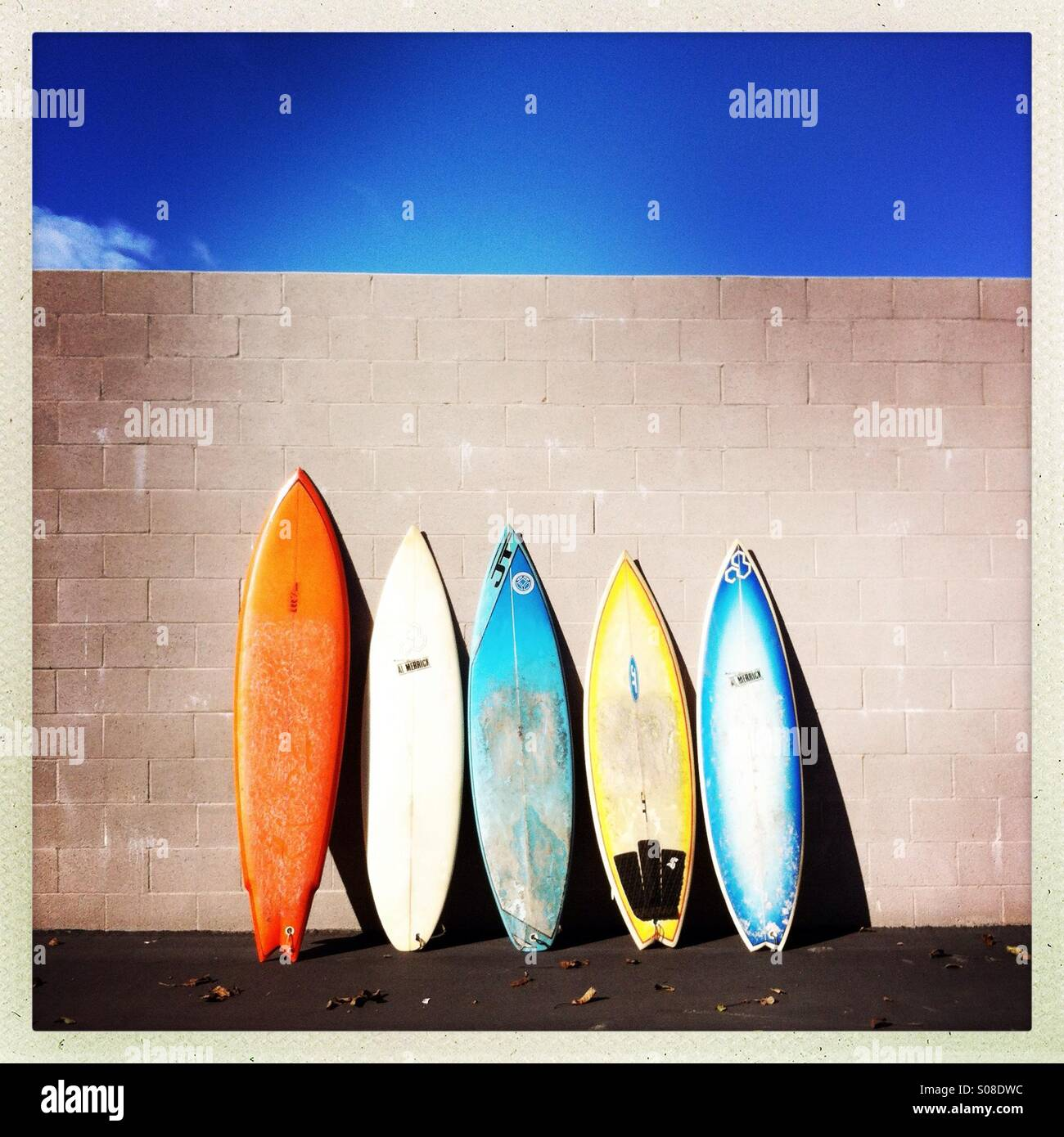 Colorful Surfboards leaning on a wall. - Stock Image