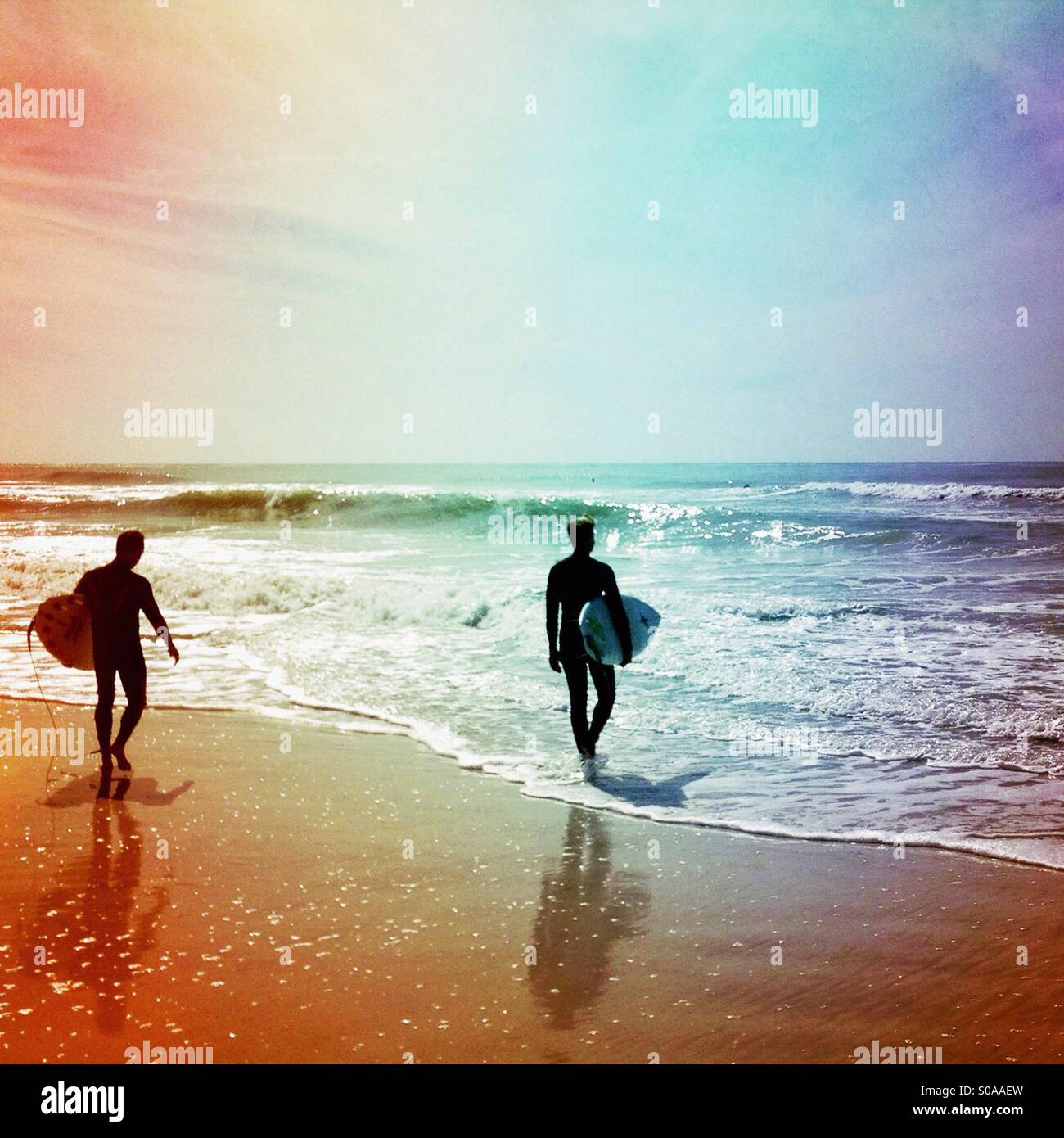 Two surfers. - Stock Image