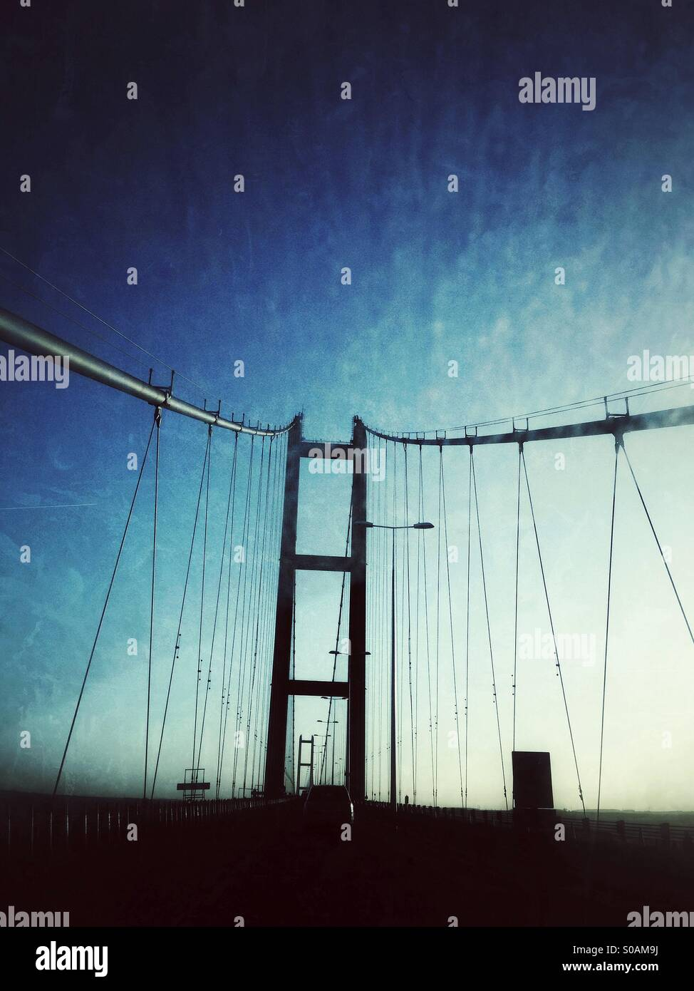 Suspension bridge at twilight - Stock Image