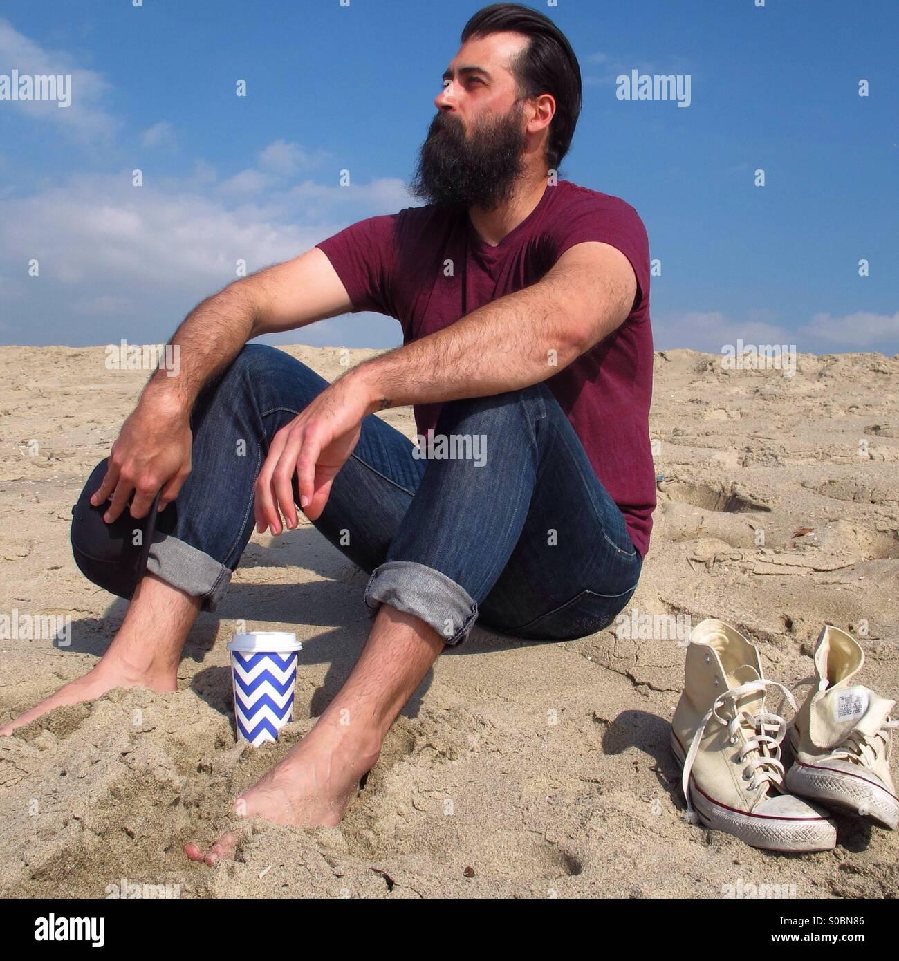 Sitting On Beach - Stock Image
