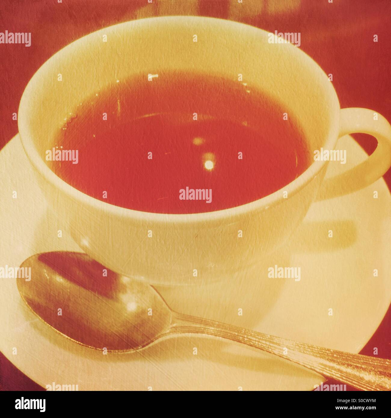 Cup of tea with vintage texture overlay. - Stock Image