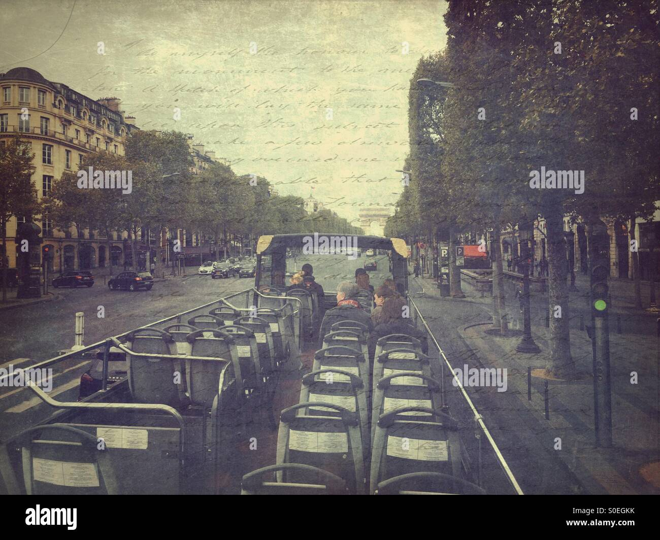 View of Champs Elysees from roof of open air sightseeing bus in Paris, France. Vintage paper texture with lettering - Stock Image