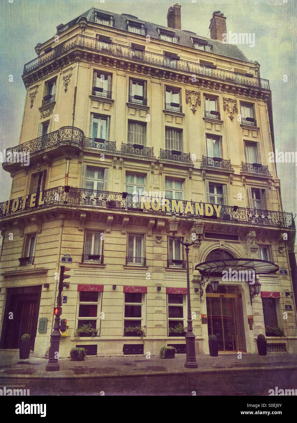 View of Hotel Normandy, located in the historic centre of Paris, France. Antique, retro look with vintage paper Stock Photo