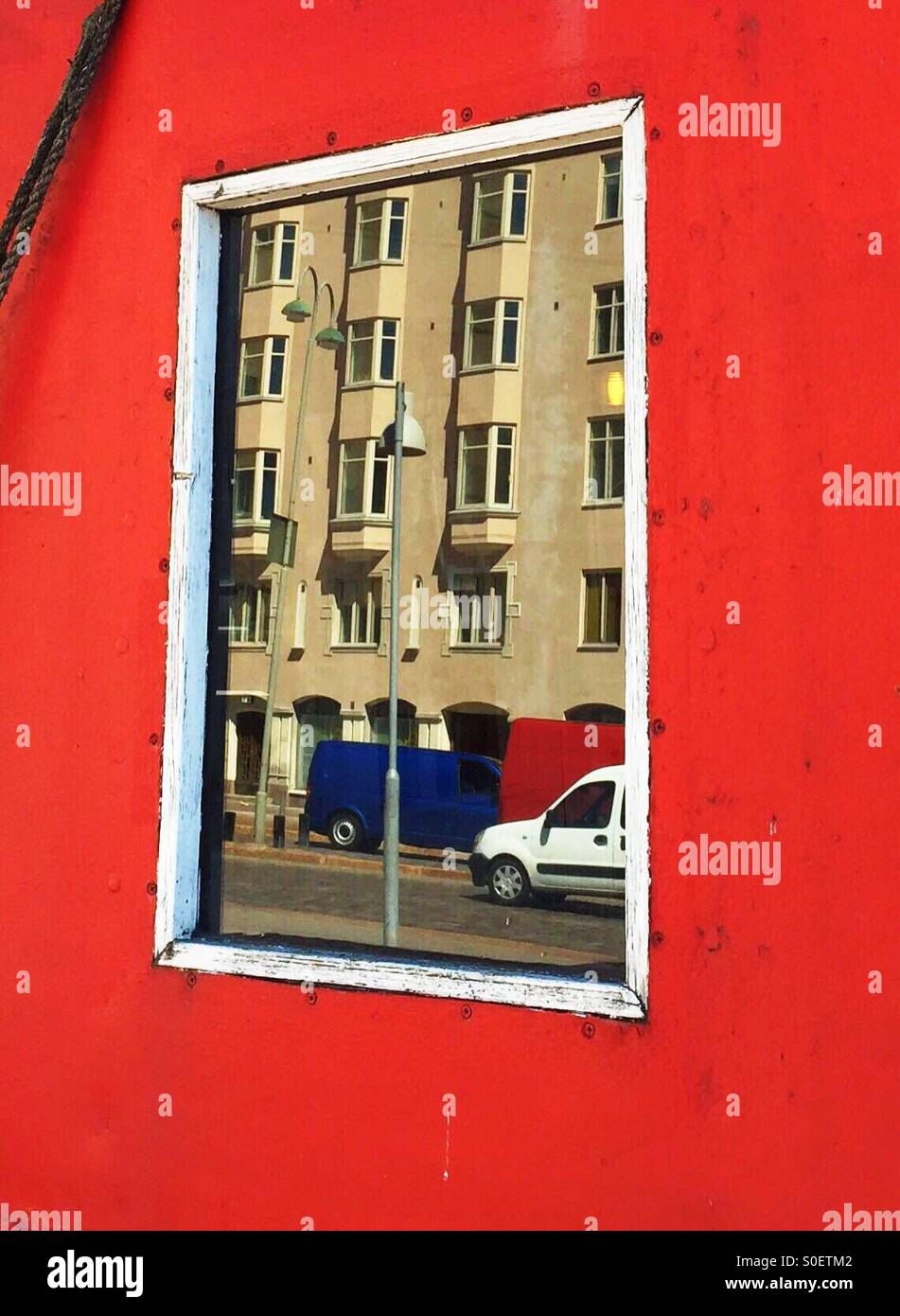 Reflection of a house on a boat window in Helsinki - Stock Image