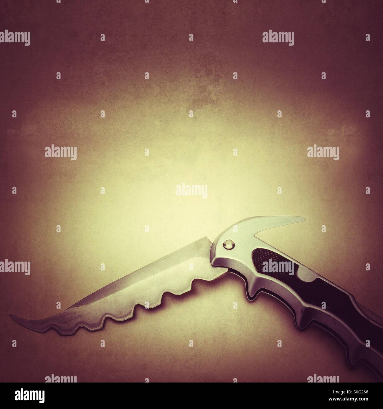 Nasty dangerous looking pocket knife manipulated to give swatted looking blade - Stock Image