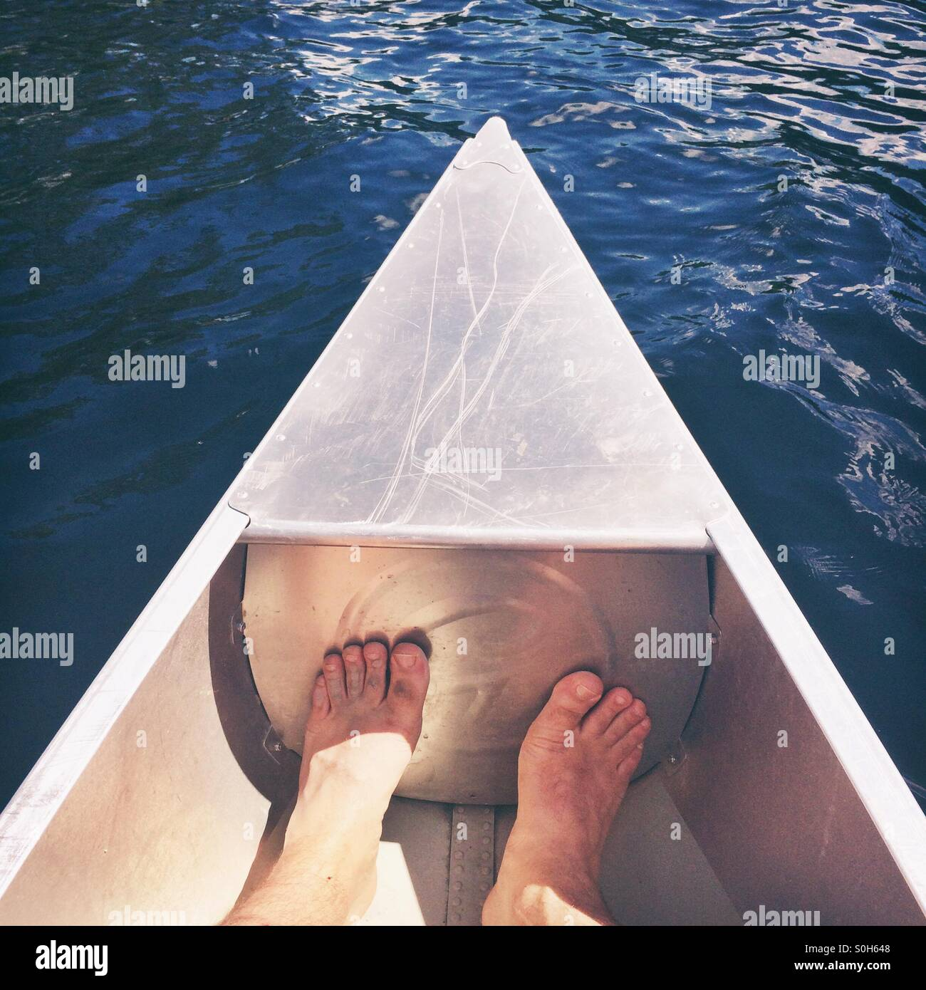 Two feet in a canoe - Stock Image