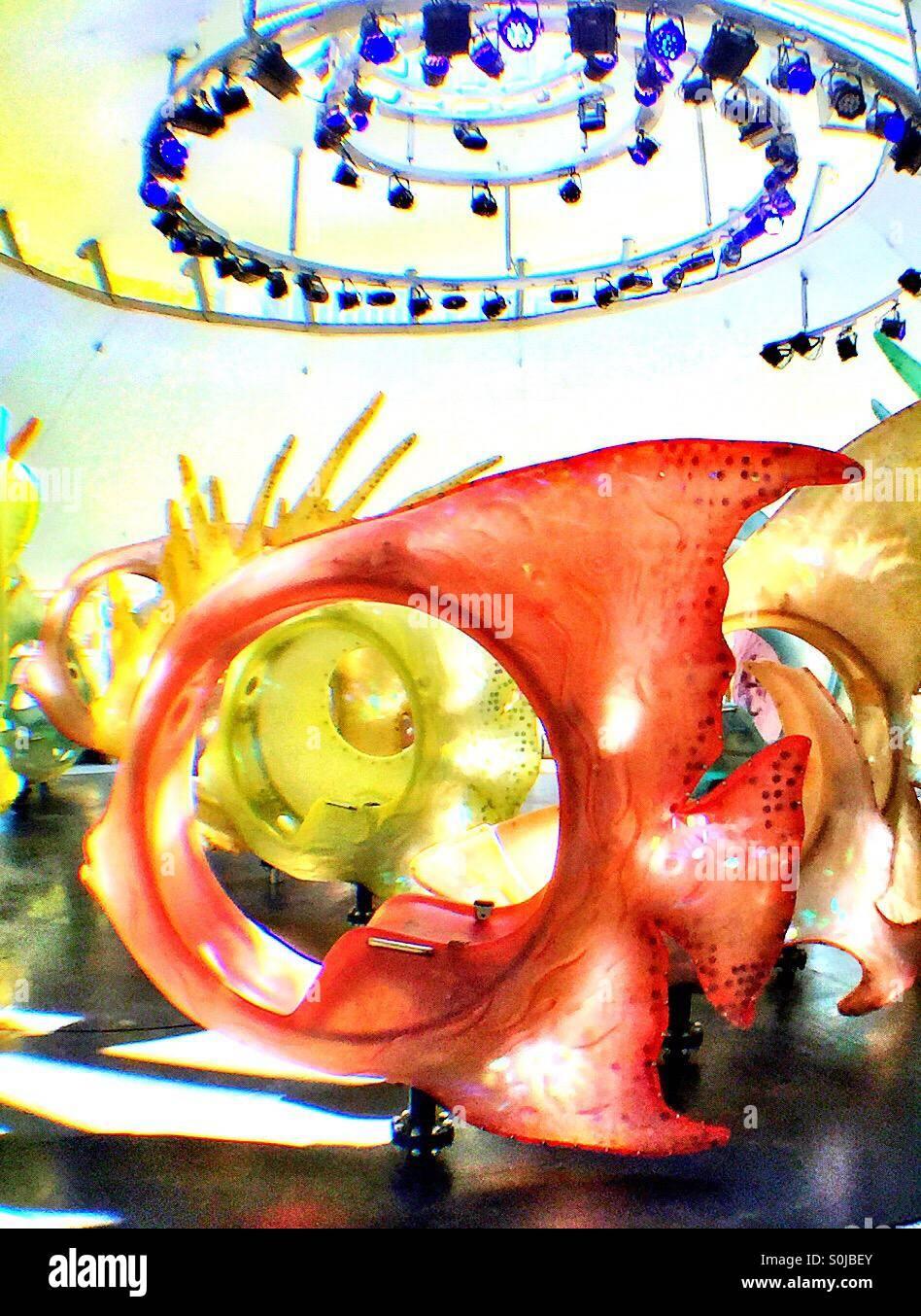 Brightly colored fiberglass fish ride at the Seaglass carousel in ...
