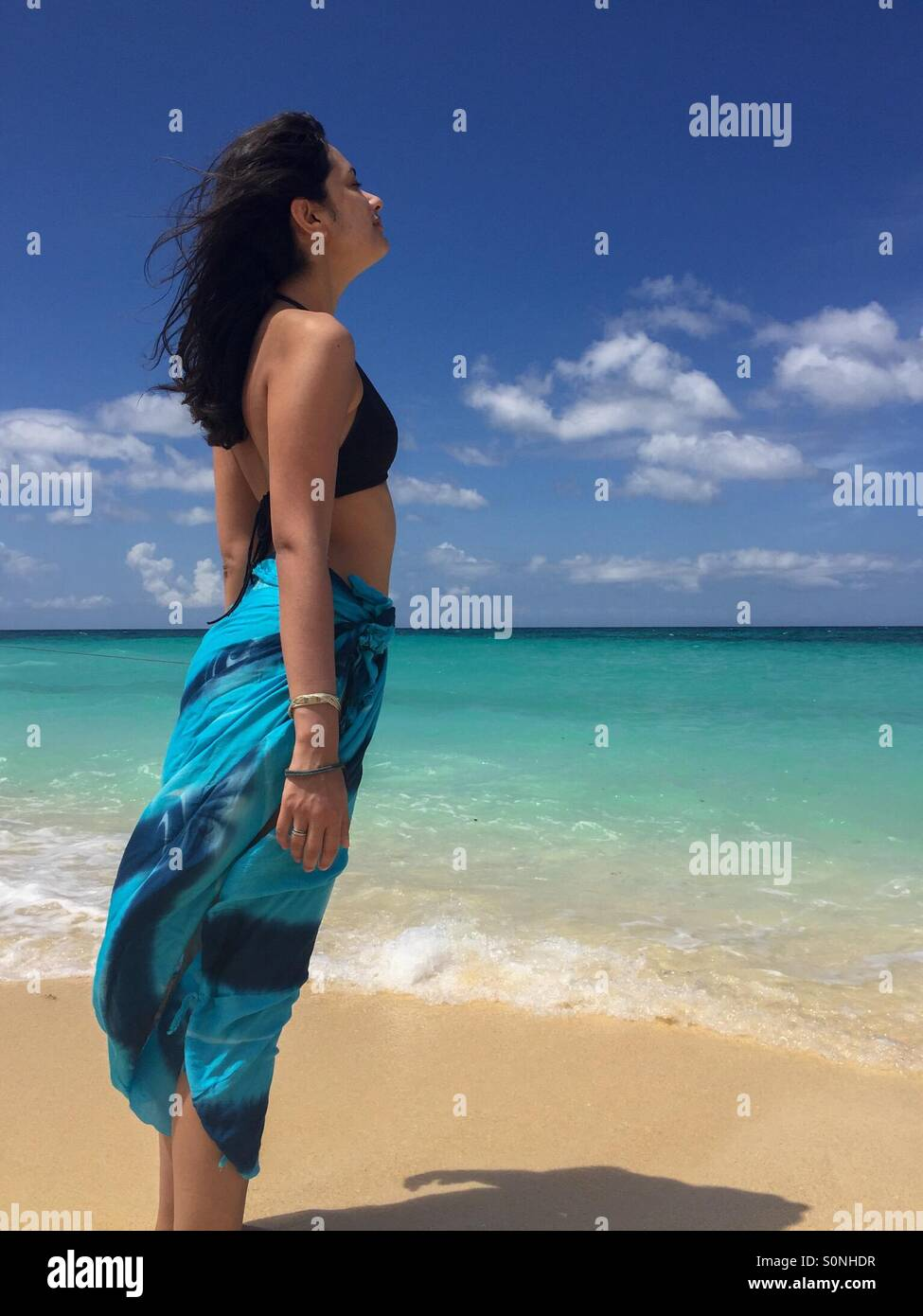 Woman breathing air - Stock Image