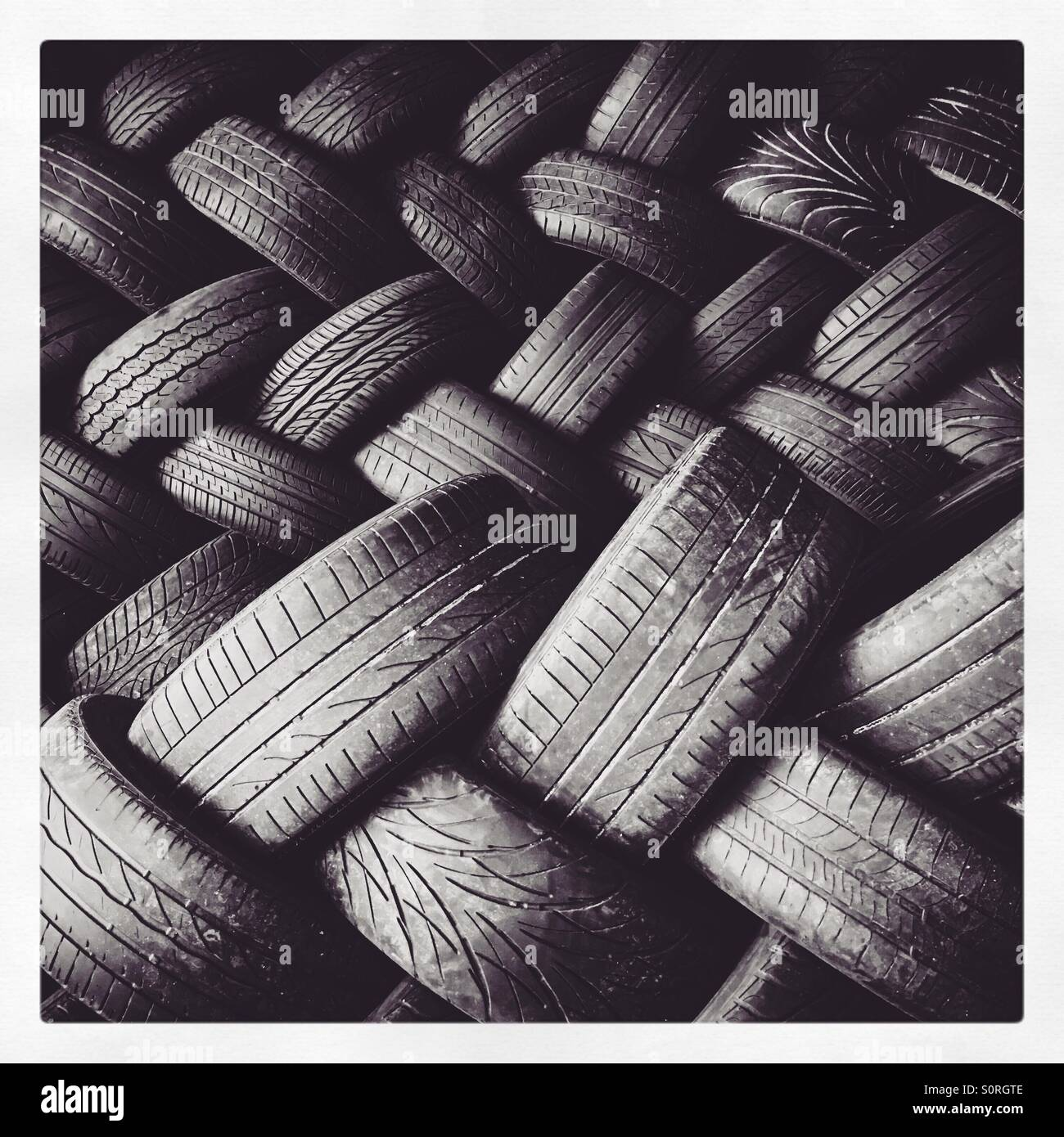 A pile of used car tyres. Stock Photo