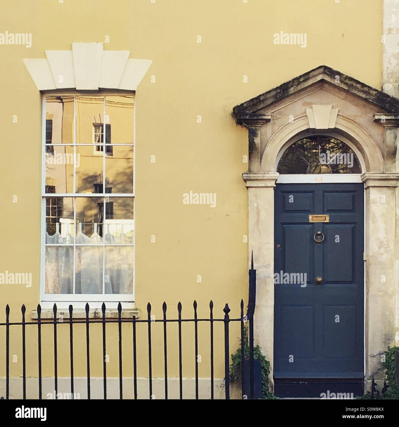 Painted yellow house with dark blue front door in Bristol Stock ...