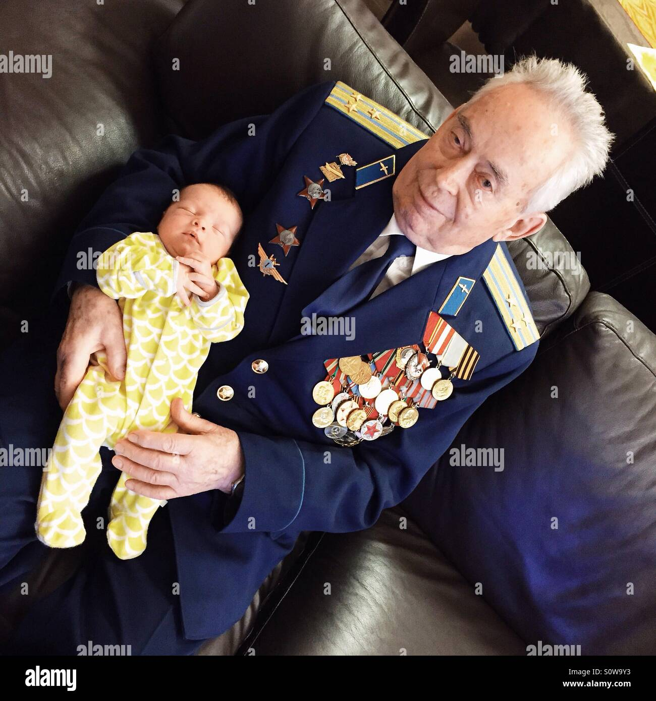 Grandfather holding a baby - Stock Image
