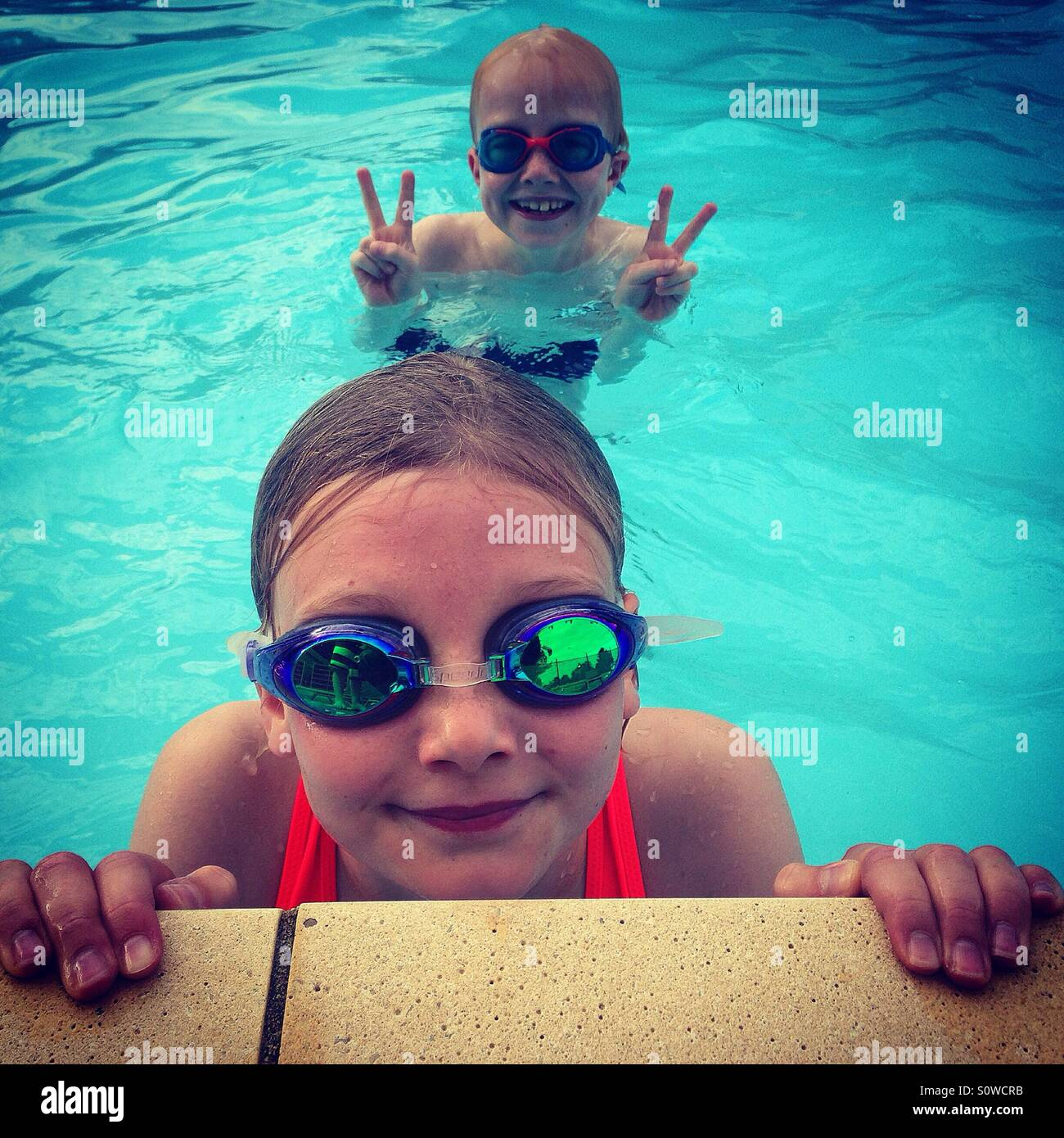 Kids in a Swimming Pool - Stock Image