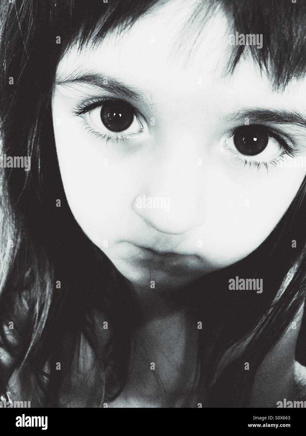 Black and white portrait of Caucasian girl. - Stock Image