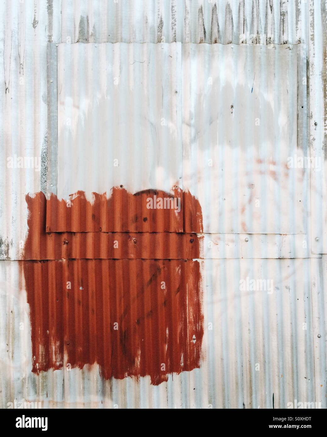 Abstract corrugated iron on the side of an industrial building in Burlington, Vermont. - Stock Image