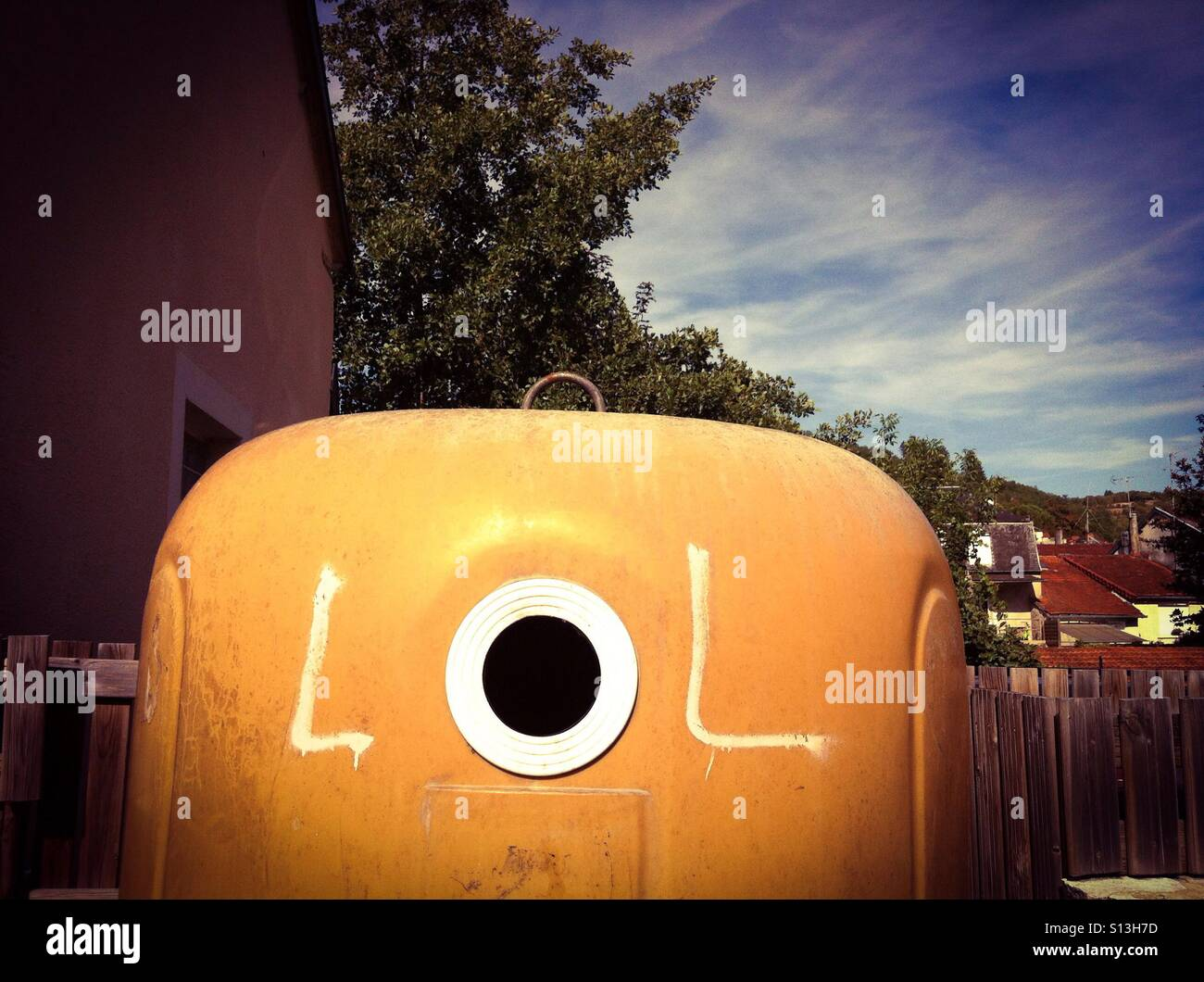 Graffiti on a recycling bin in France - Stock Image