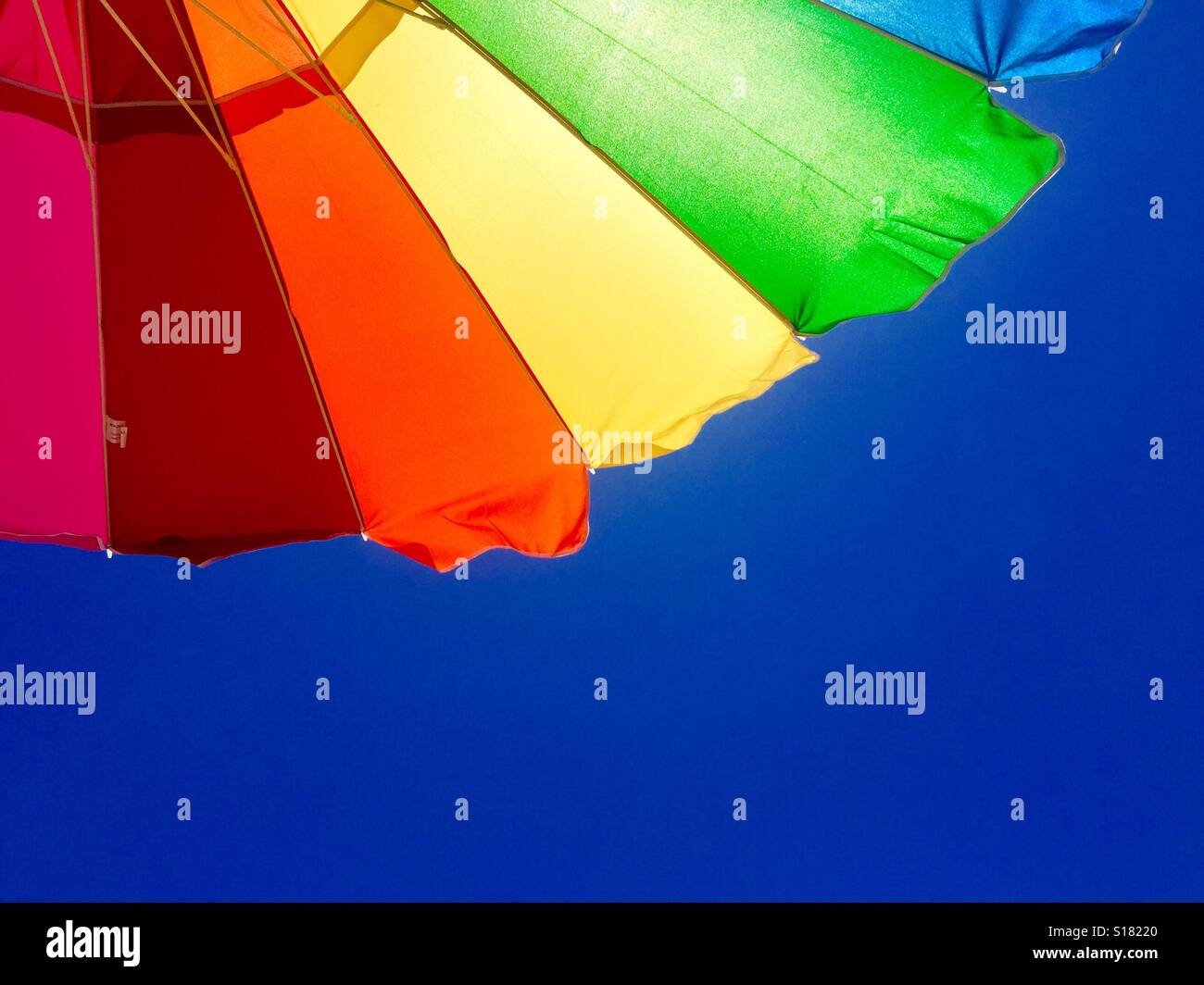 Rainbow on a blue sky Stock Photo
