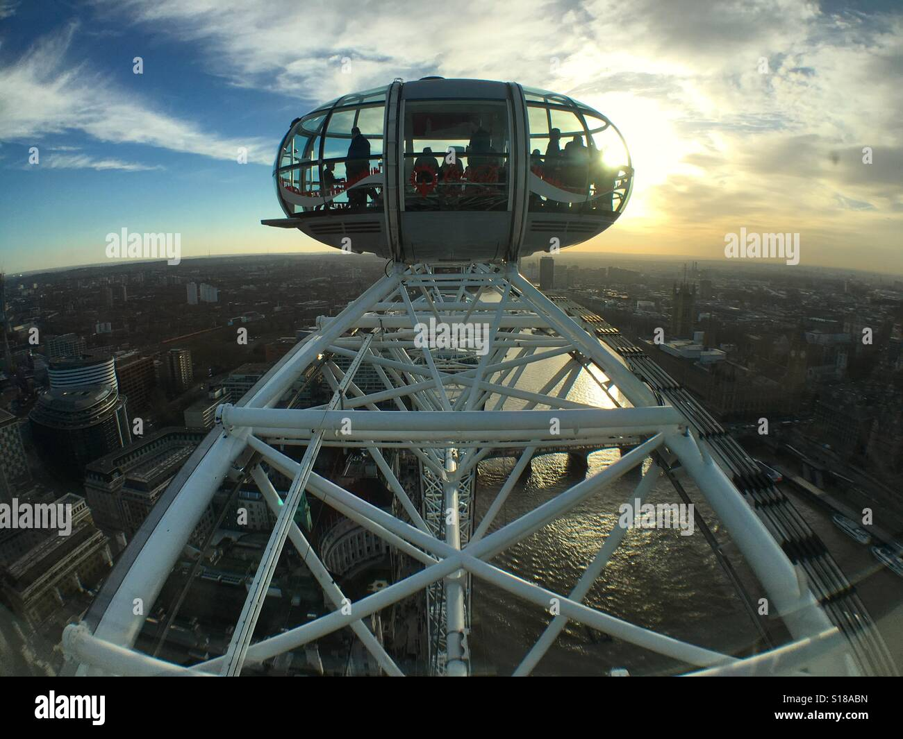 London Eye capsule and its supporting structure against the sunset Stock Photo